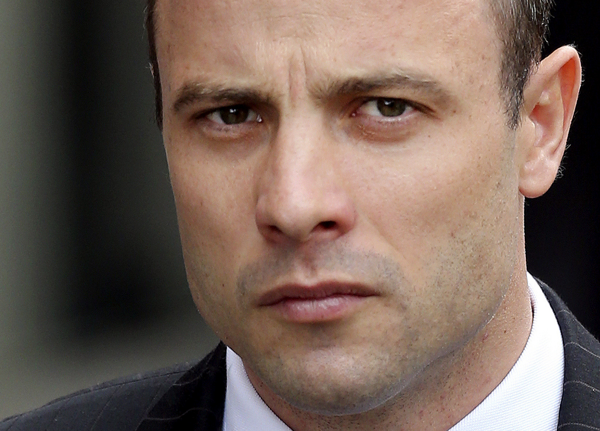 Oscar Pistorius arrives at the high court in Pretoria, South Africa, Wednesday, April 9, 2014. P