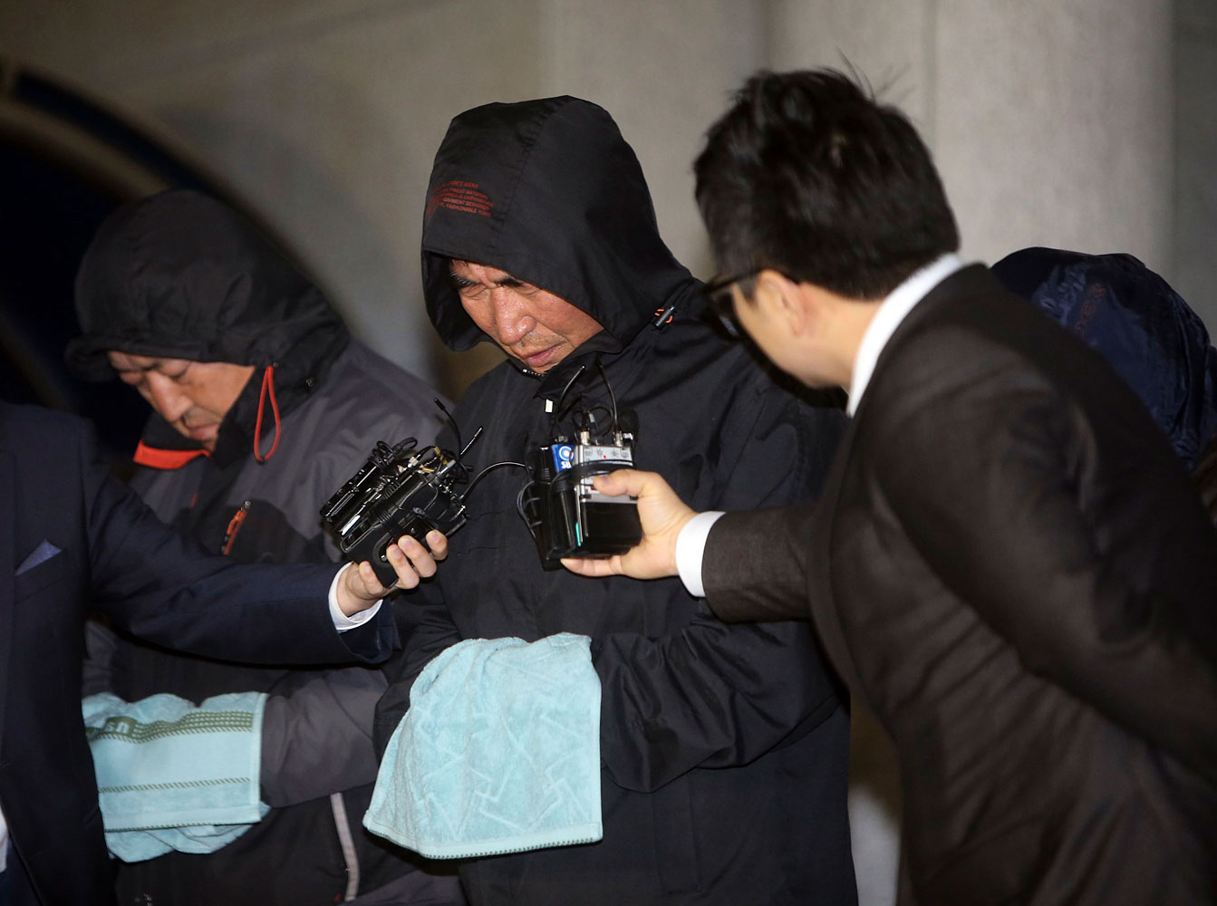 Lee Joon-seok, captain of South Korean ferry Sewol, which sank at sea off Jindo,  walks out of court in Mokpo, South Korea, on April 19, 2014