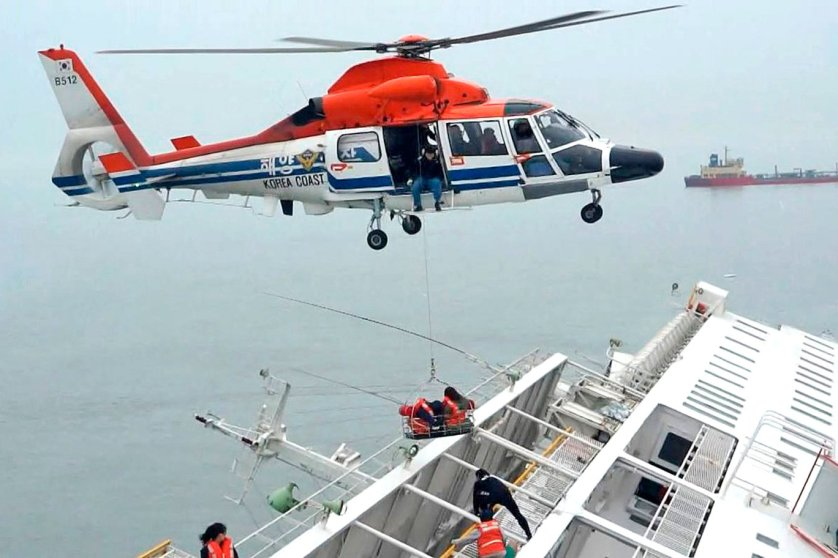 "A maritime police helicopter rescues passengers who were onboard South Korean ferry ""Sewol"" which capsized off Jindo April 16, 2014."