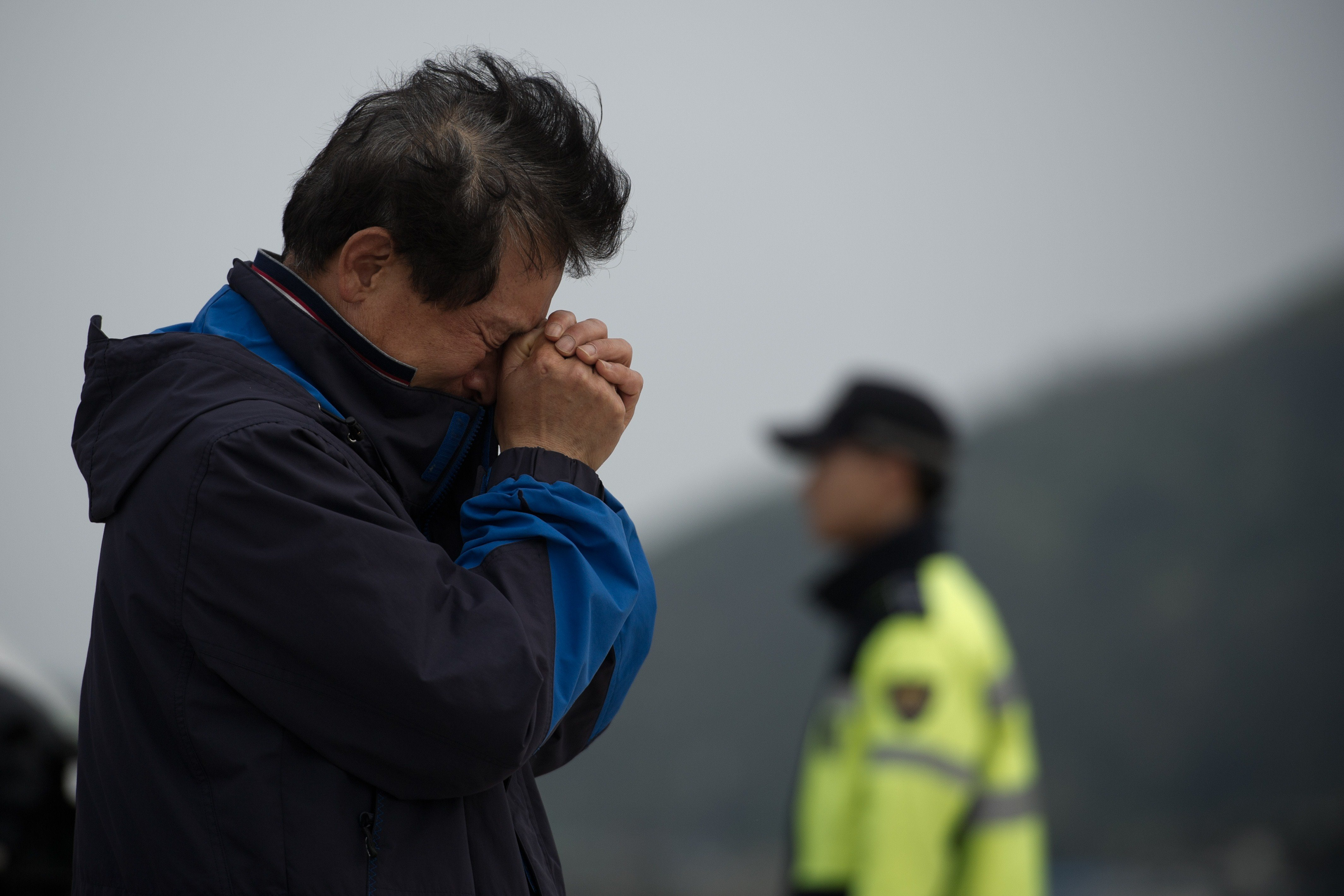 A relative weeps at an area where family members of victims of the South Korean ferry 'Sewol' are gathered, at Jindo harbour on April 21, 2014.