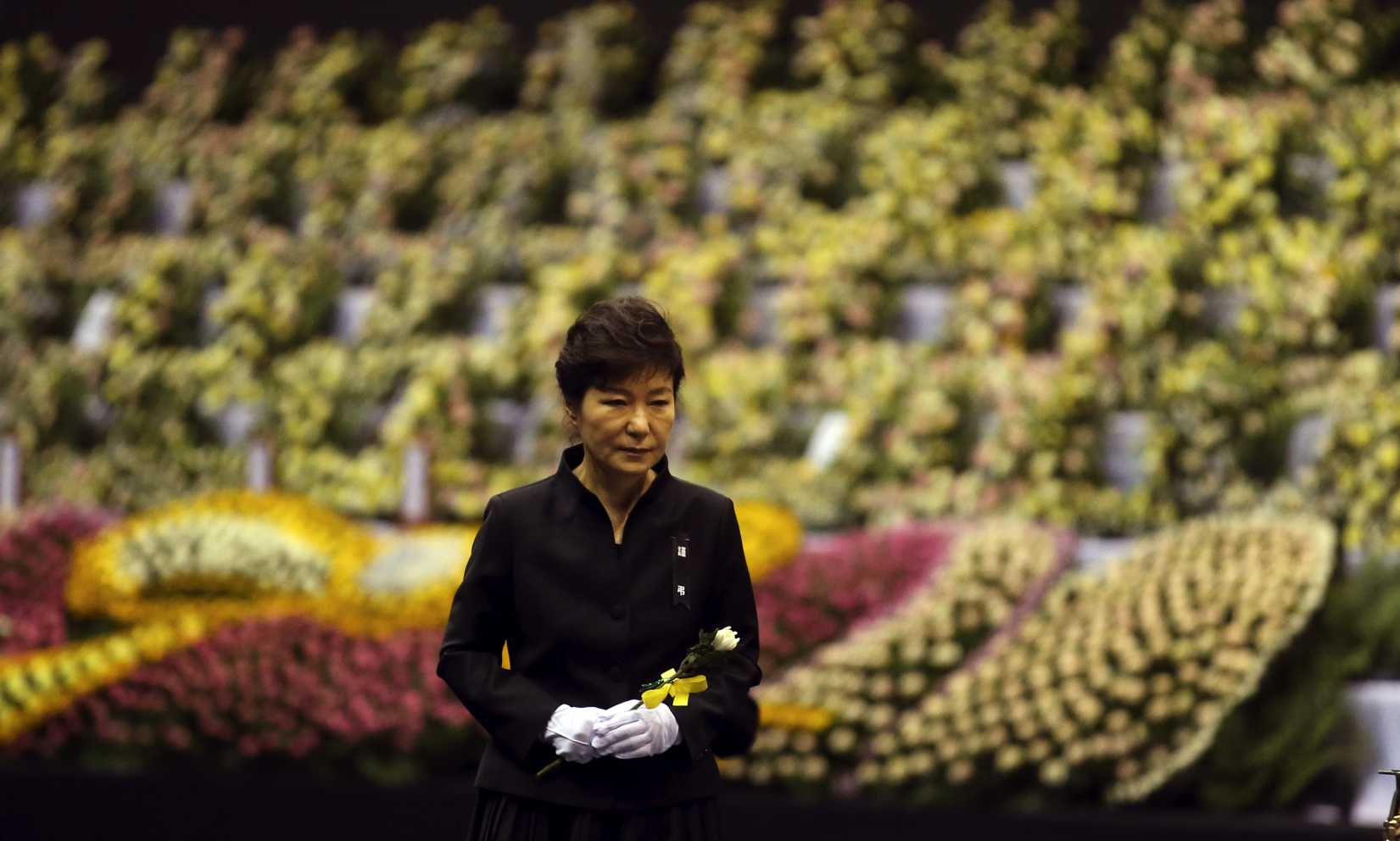 South Korean President Park Geun-hye pays tribute to the victims of the sunken ferry Sewol at a group memorial altar in Ansan, south of Seoul, on Tuesday, April 29, 2014