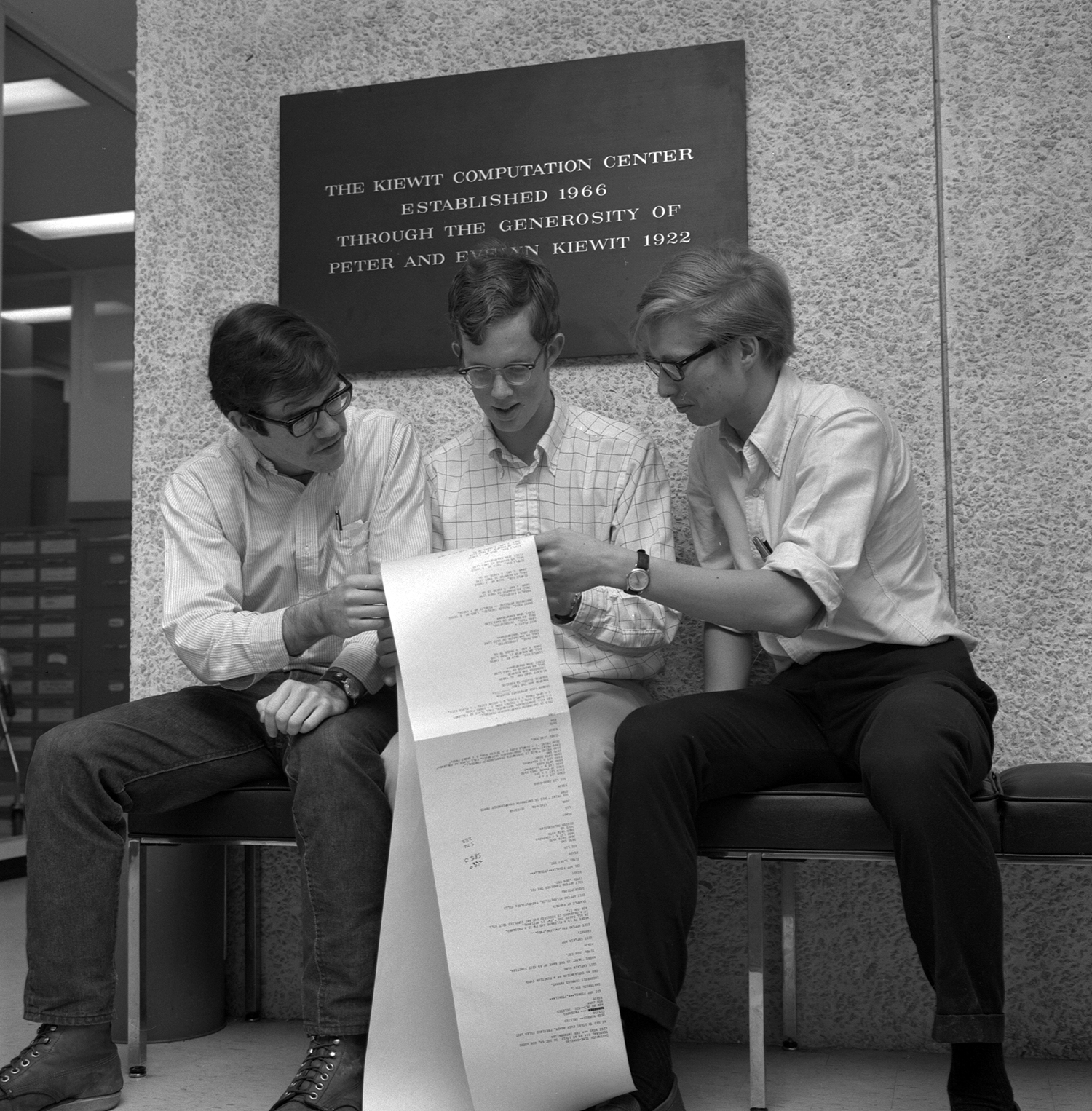 Dartmouth students study a program at the school's Kiewit Computation Center in 1969
