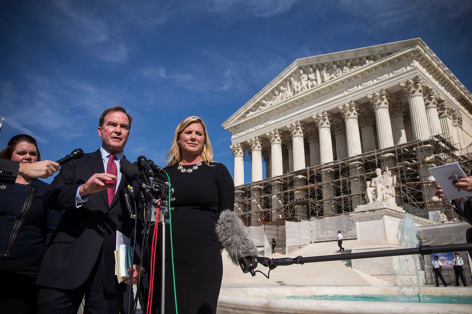 Jennifer Gratz, right, CEO of XIV Foundation and Michigan Attorney General Bill Schuette speak during a press conference outside the Supreme Court after going before the Supreme Court in  Schuette v. Coalition to Defend Affirmative Action  on Oct. 15, 2013 in Washington, DC.