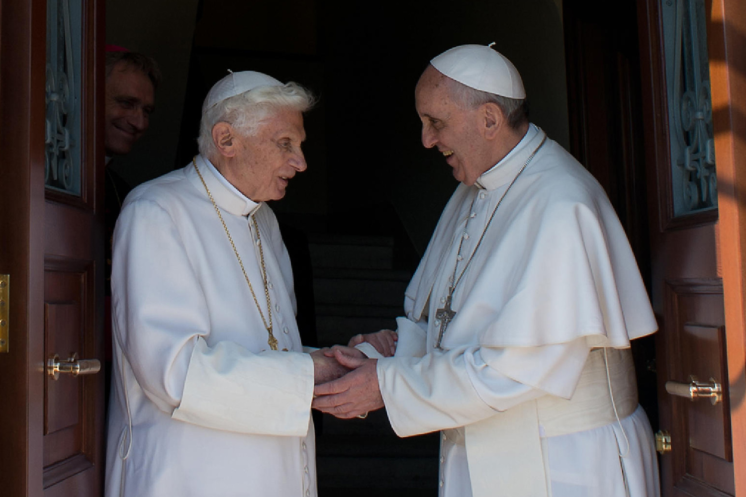 Welcoming Pope emeritus Benedict XVI as he returns to the Vatican from the pontifical summer residence of Castel Gandolfo.