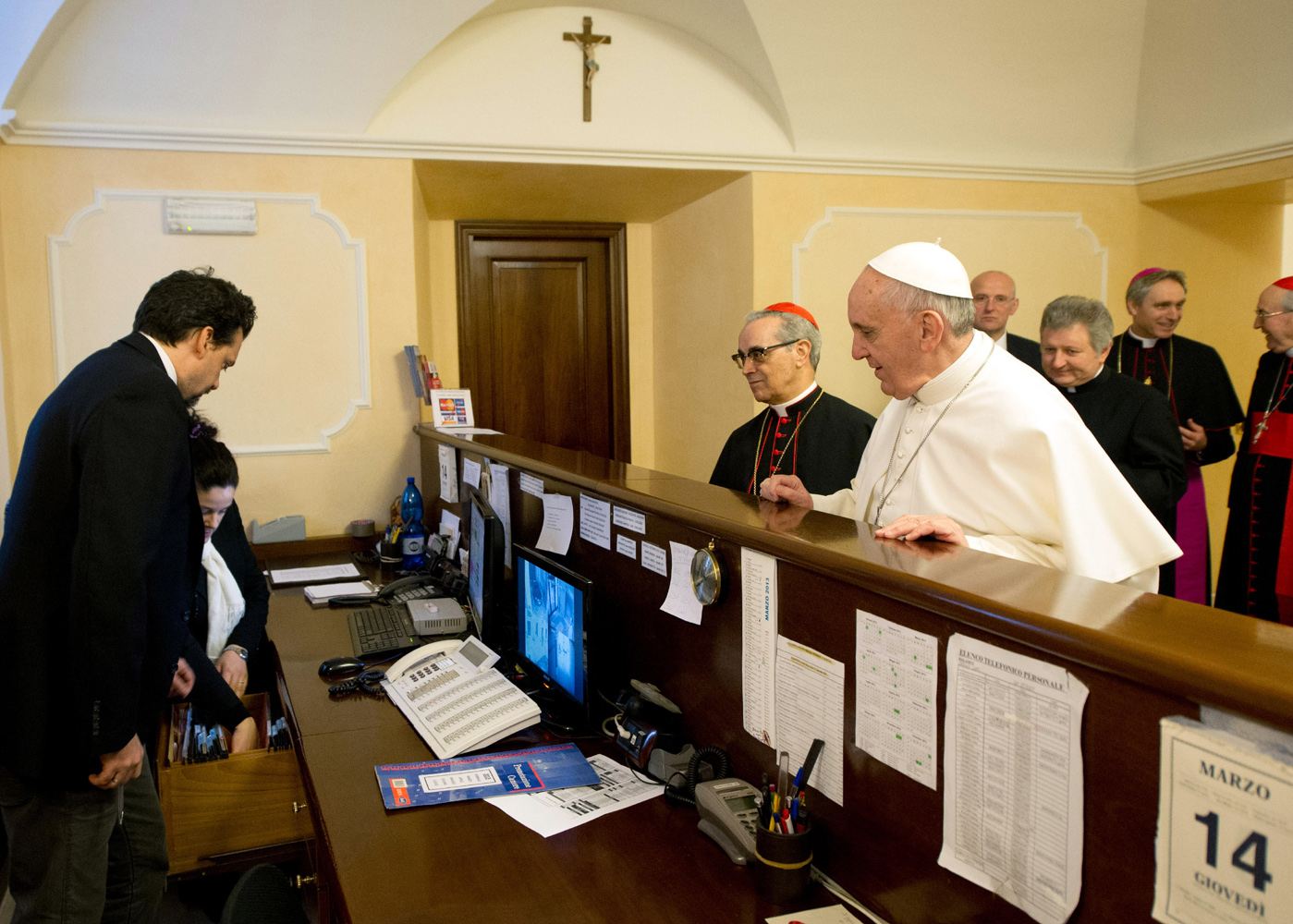 Paying the bill at Rome's Domus Internationalis Paulus VI hotel, where Pope Francis stayed as a cardinal before entering the conclave and being elected pope.
