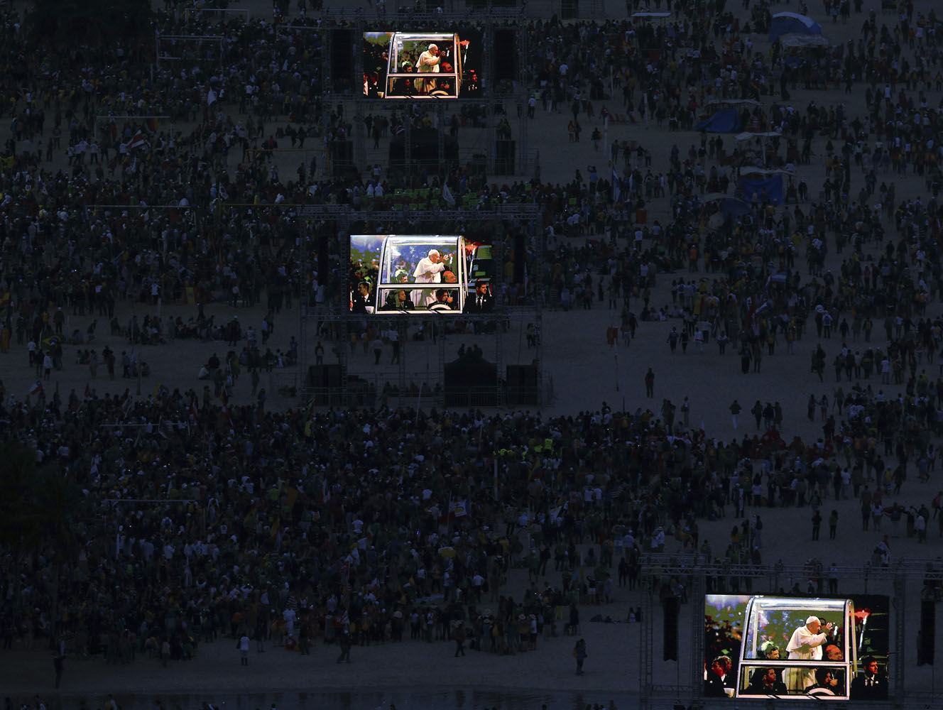 Images of Pope Francis projected onto screens at Copacabana beach in Rio de Janeiro.