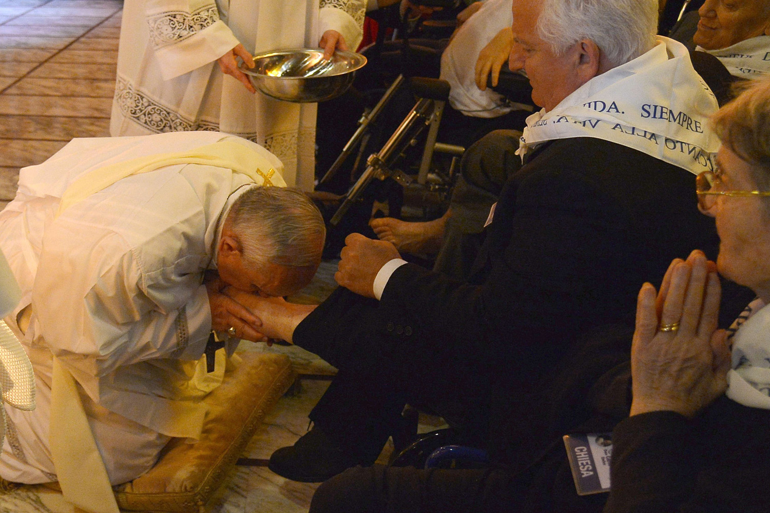 Kissing a man's at the traditional Washing of the Feet.