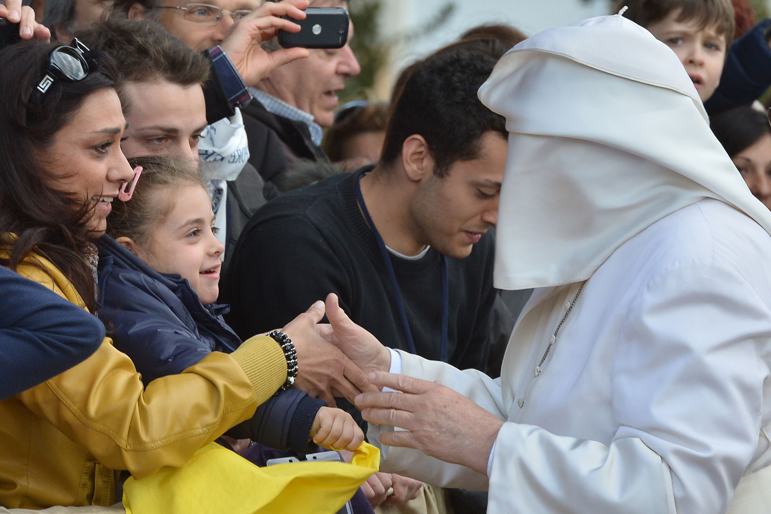 A wind gust lifts Pope Francis's mantle as he arrives at the traditional Washing of the Feet during Holy Thursday.