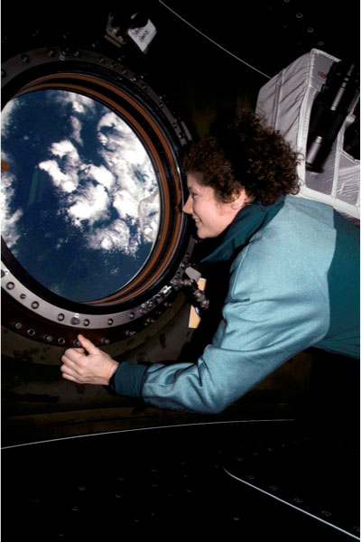 NASA Astronaut Susan J. Helms, flight engineer, views the topography of a point on Earth from the nadir window in the U.S. Laboratory / Destiny module of the International Space Station (ISS), on March 31, 2001. Helms is now a three-star lieutenant general in the United States Air Force.