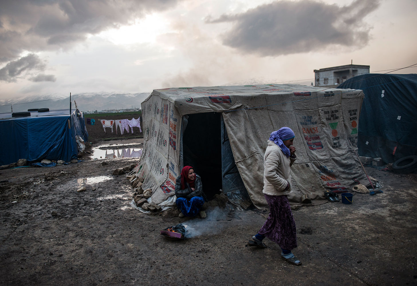 Seventy families live by the shell of an abandoned onion-processing factory, trudging through the mud in flip-flops. Many had to bail water from their tents after a rainstorm. They pay between US$50 and US$200 a month to live here in Faida, Bekaa Valley.