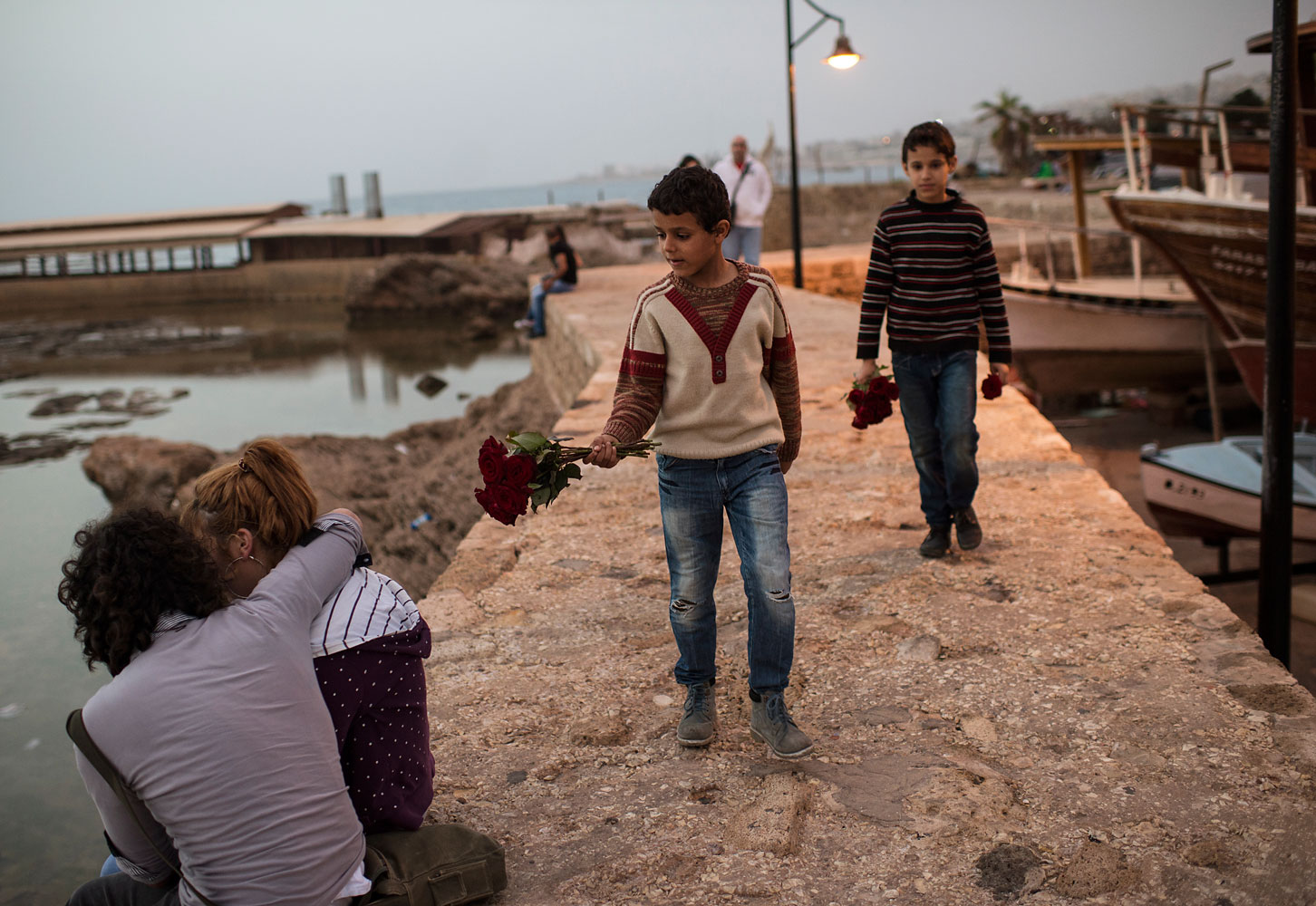 "Manhal, aged nine, and Ahmed, 11, brothers from the northern Syrian city of Aleppo, sell flowers by the sea in Byblos. They go to school by day, and work all evening. Their older brother doesn't go to school at all. ""I would if I could,"" says Mohammed. ""But who would help my father with the rent?"""