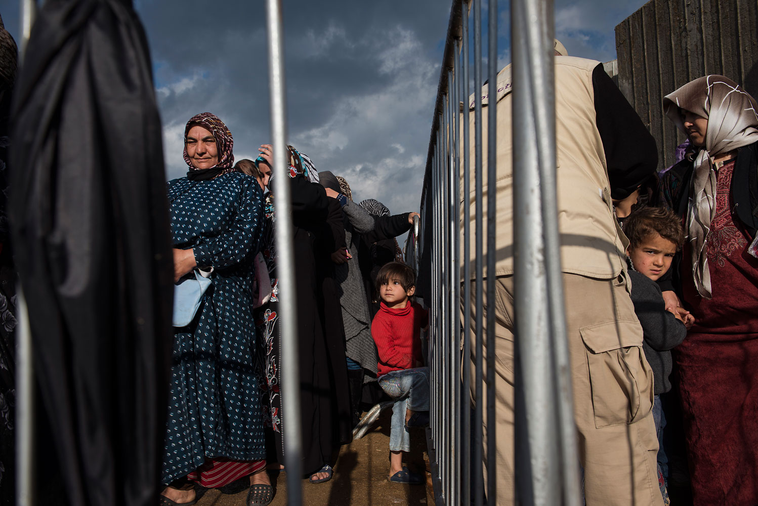 Syrian refugees line up to register or renew their registration at the UNHCR compound in Tripoli, in North Lebanon.