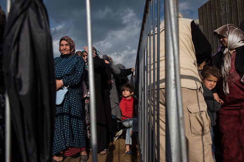 Syrian refugees line up to register or renew their registration at the UNHCR compound in Tripoli, in North Lebanon, March 11, 2014.