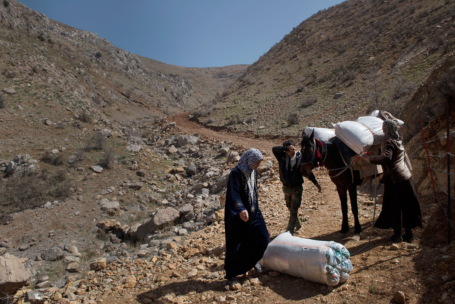 Syrian refugees from the Syrian village of Beit Jinn return from the Lebanese border town of Shabaa back across the mountains of Jabal al Sheikh into Syria. The wife and daughter-in-law of Mohammed Kablan, 56, (not shown) were tired of living as a family of refugees, and found Lebanon too expensive compared to Syria.