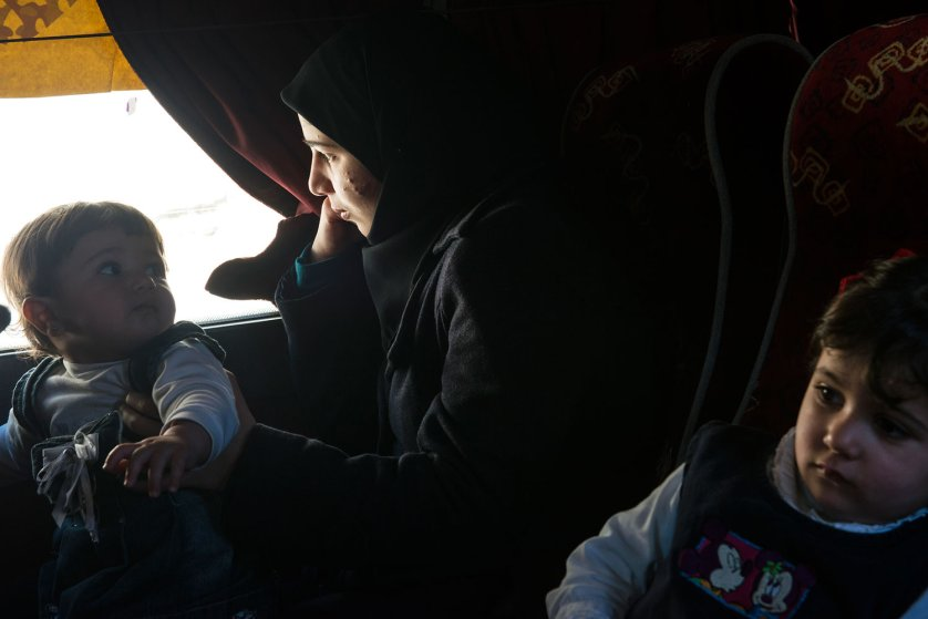 Syrian refugees from the southern border areas gather in the village of Blat, in Marjaayoun, to be bussed to Tyre to register with UNHCR after arriving in Lebanon, March 5, 2014.