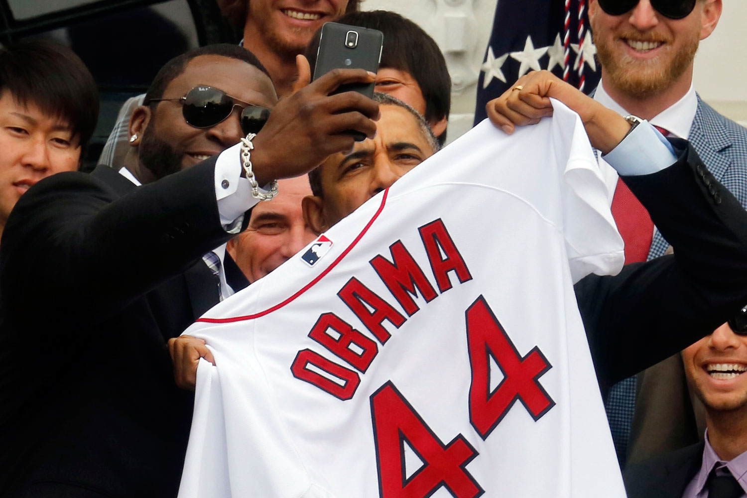 U.S. President Barack Obama poses with star player David Ortiz for a  selfie  as he welcomes the 2013 World Series Champion Boston Red Sox to the South Lawn of the White House in Washington, April 1, 2014.