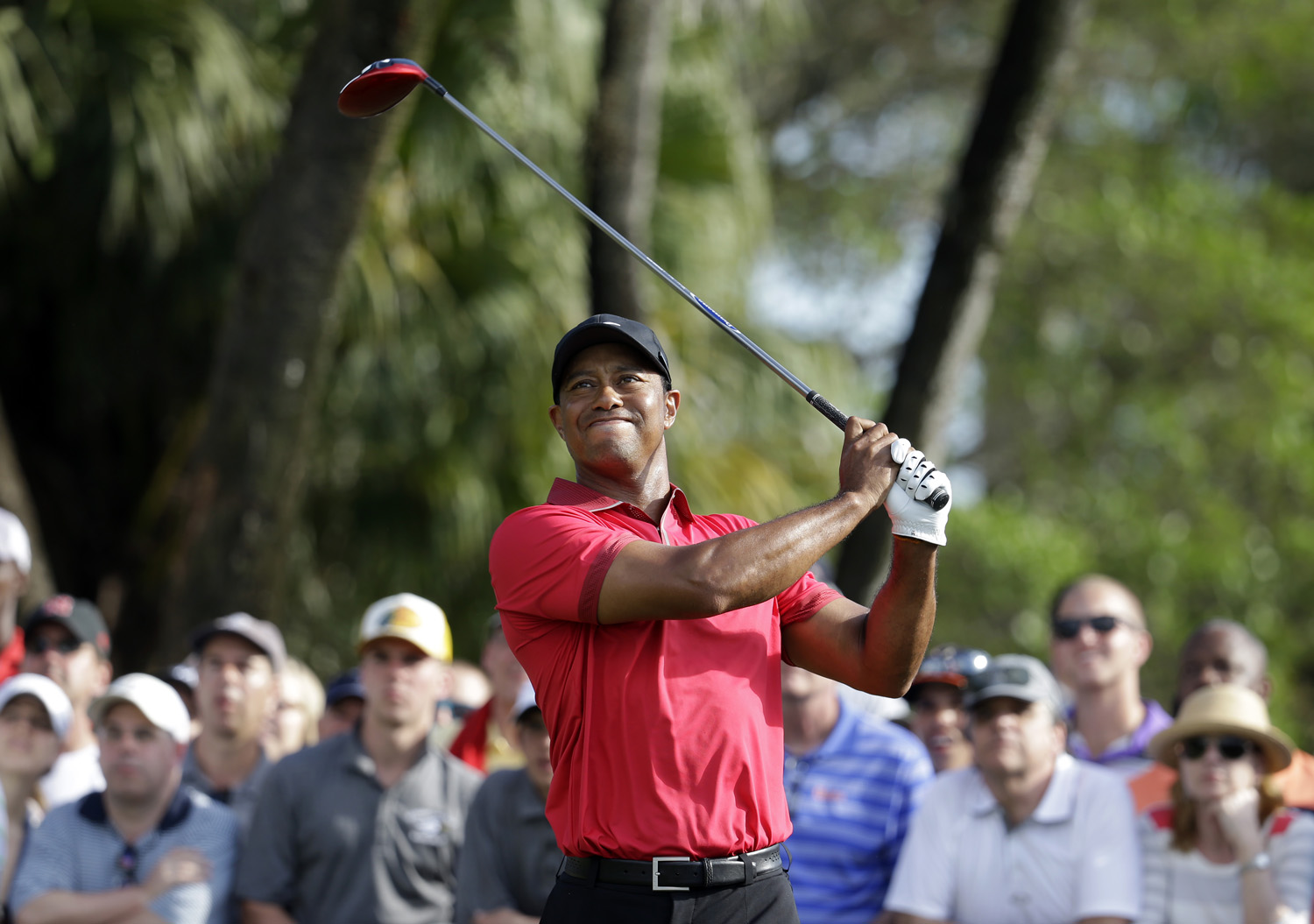Tiger Woods watches his tee shot on the 12th hole during the final round of the Cadillac Championship golf tournament March 9, 2014, in Doral, Fla.