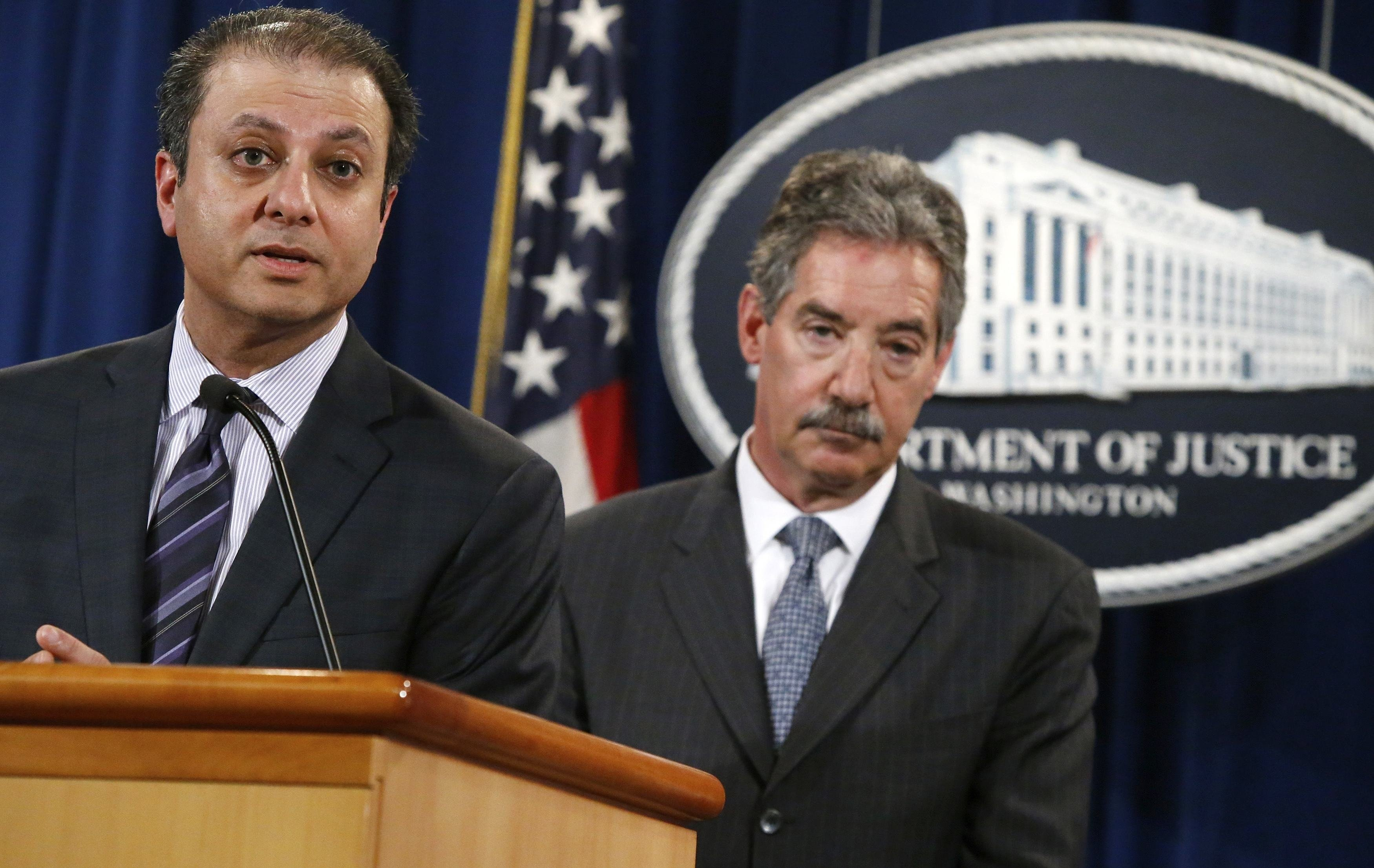 U.S. Attorney for the Southern District of New York Preet Bharara speaks while flanked by U.S. Deputy Attorney General James Cole as they announce a settlement with Anadarko Petroleum Corp at the Justice Department in Washington, April 3, 2014.