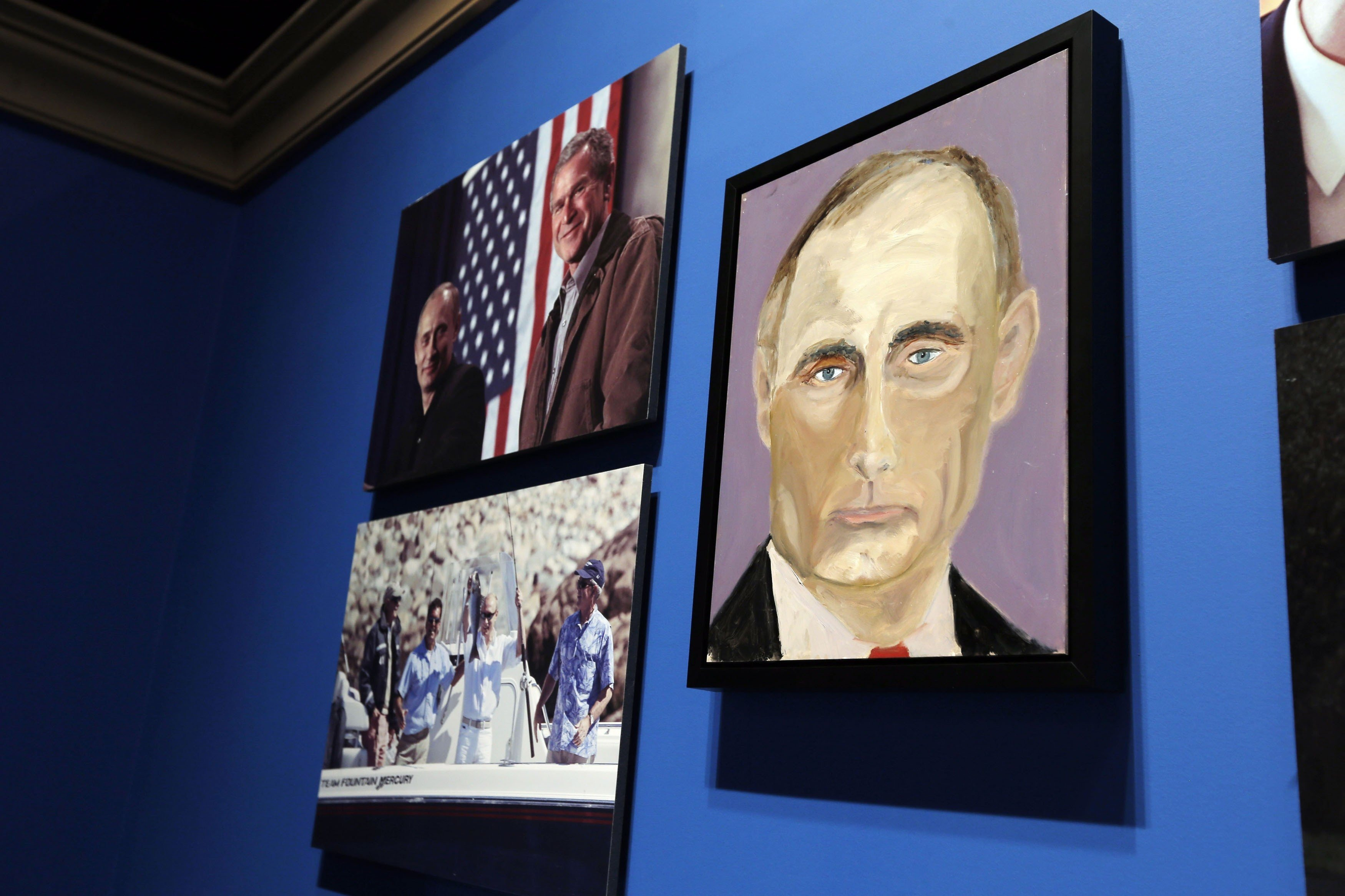A portrait of Russian President Vladimir Putin, painted by former U.S. President George W. Bush, is displayed at  The Art of Leadership: A President's Personal Diplomacy  exhibit at the Bush Presidential Library and Museum in Dallas, April 4, 2014.