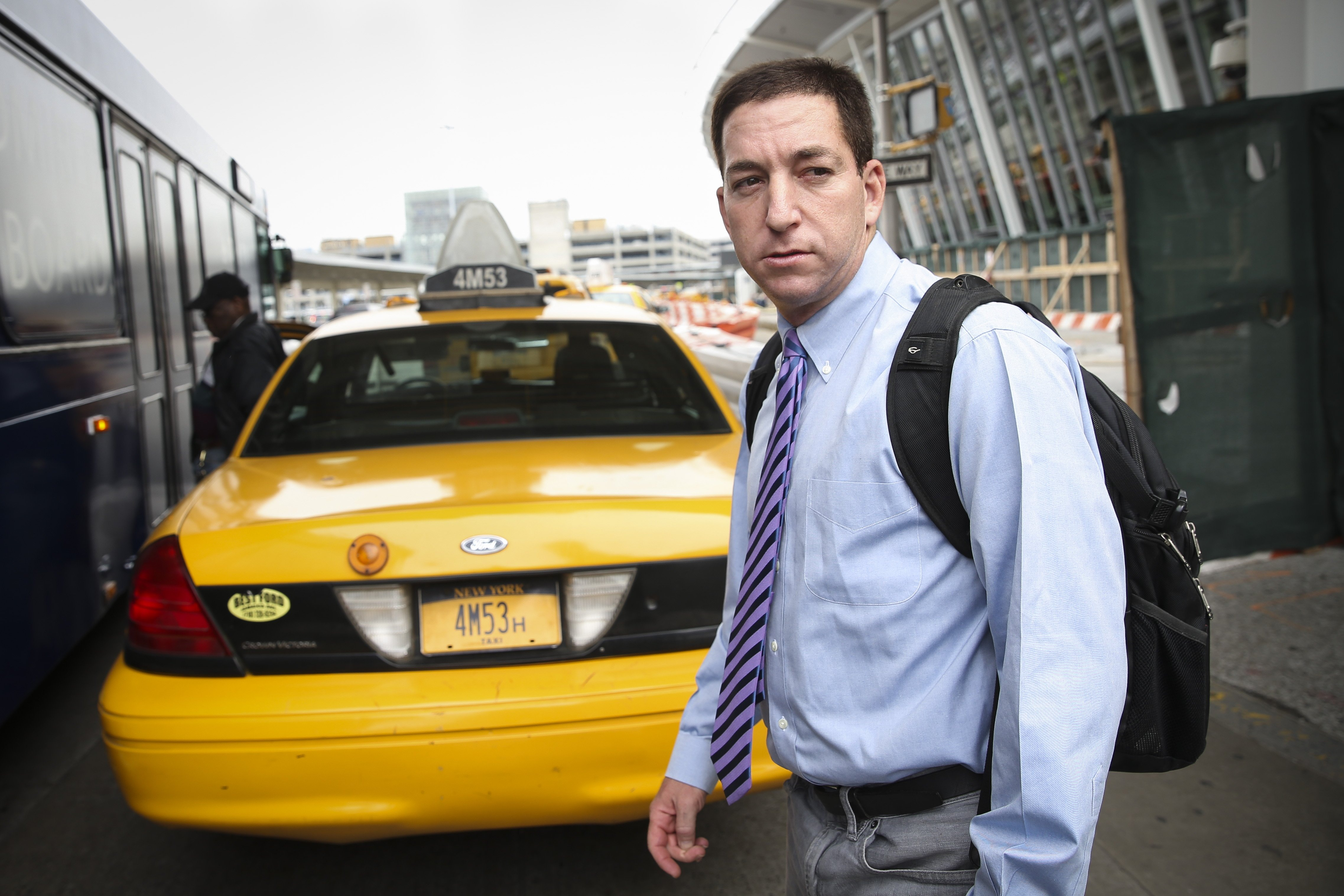 Glenn Greenwald arrives at John F. Kennedy International Airport in New York, April 11, 2014.