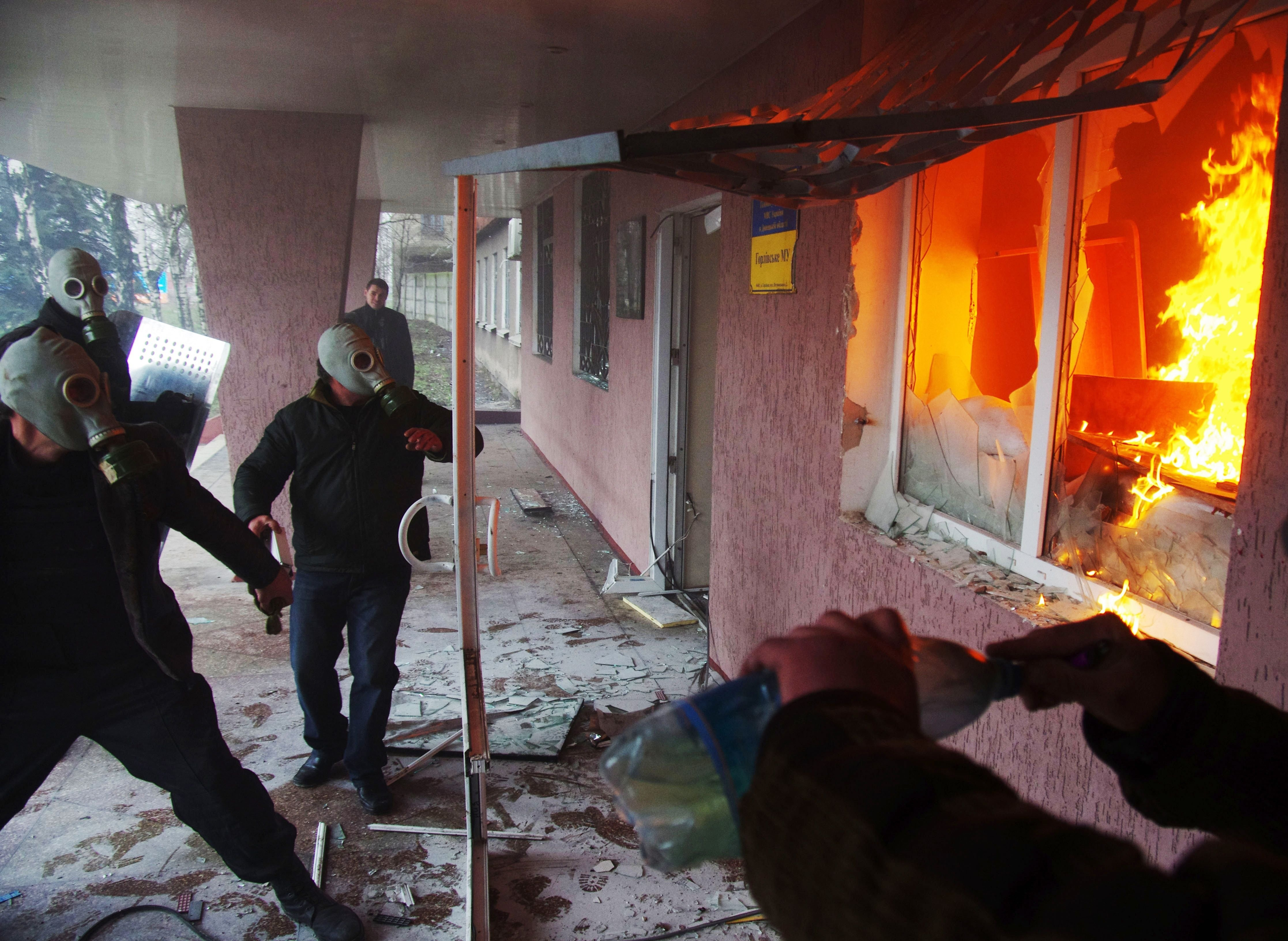 Rising tension Pro-Russian protesters storm a regional police building in the eastern Ukrainian city of Horlivka