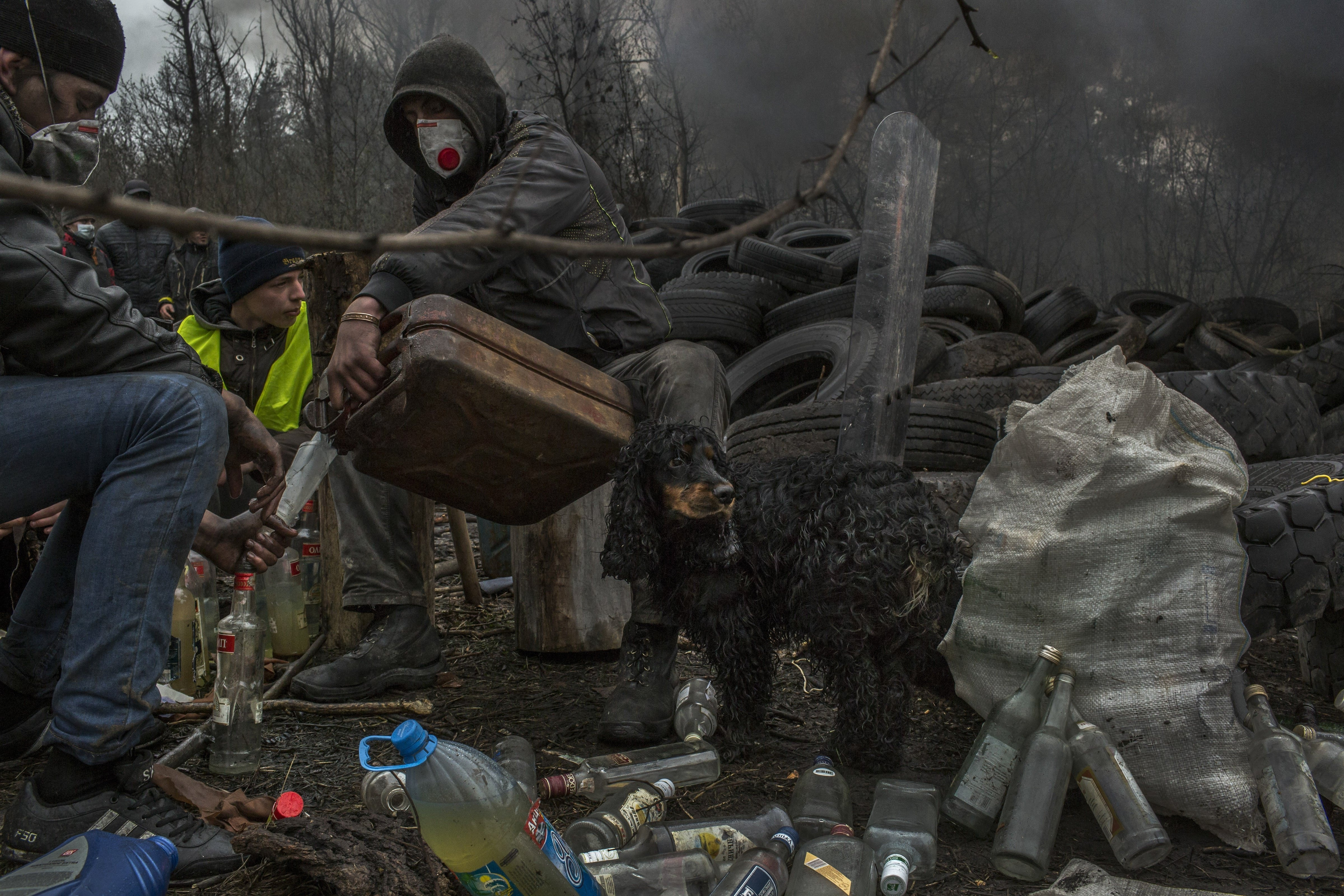 Cheers to Moscow Pro-Russian protesters make Molotov cocktails in Solvyansk, in eastern Ukraine