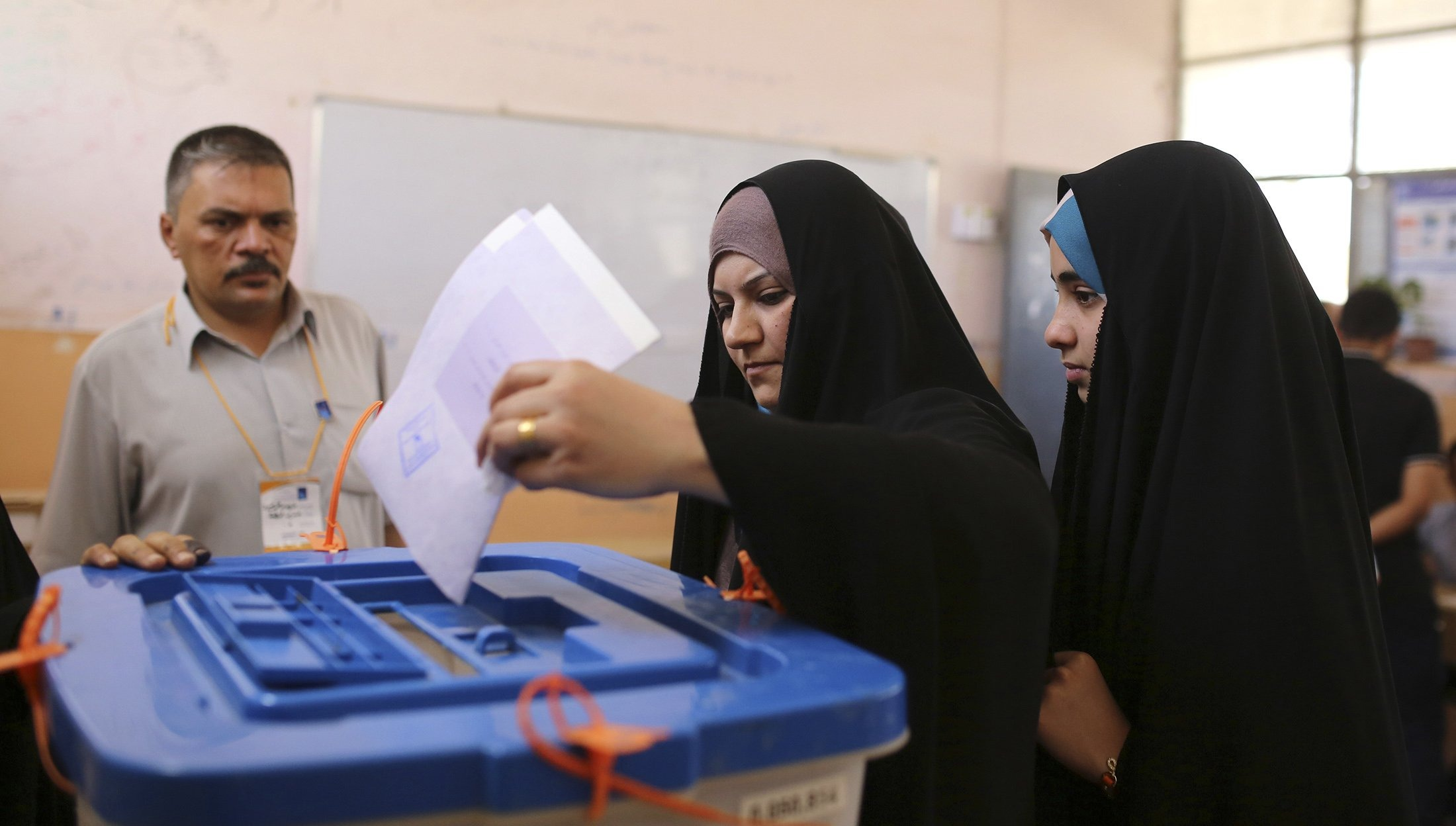 A resident casts her ballot at a polling station in Najaf, Iraq, on April 30, 2014