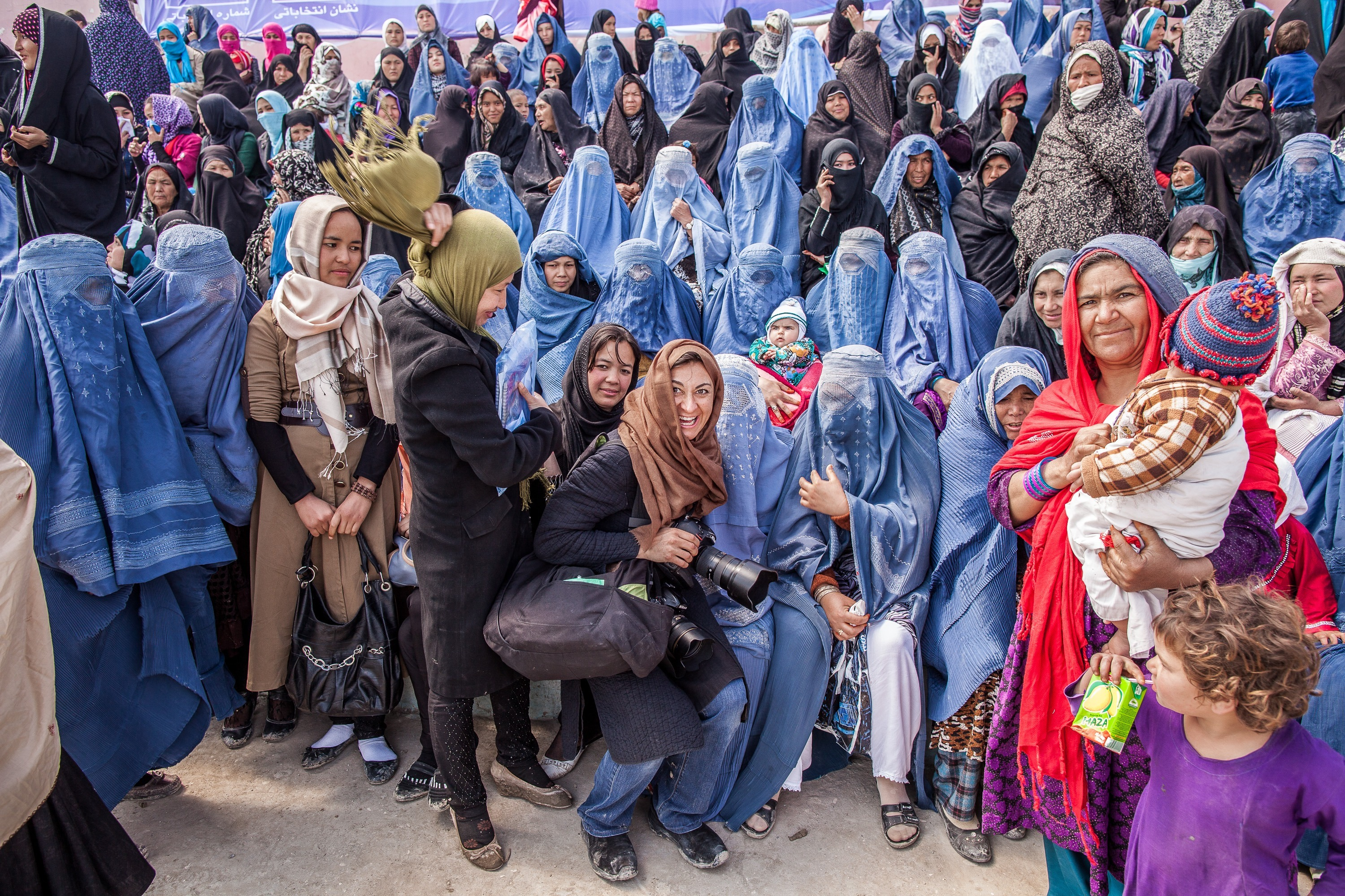 Lynsey Addario with Afghan women attending a rally for Presidential candidate Zalmai Rassoul with Vice Presidential candidate Habiba Sarabi, in Mazar-e-Sharif, Afghanistan, March 27, 2014.