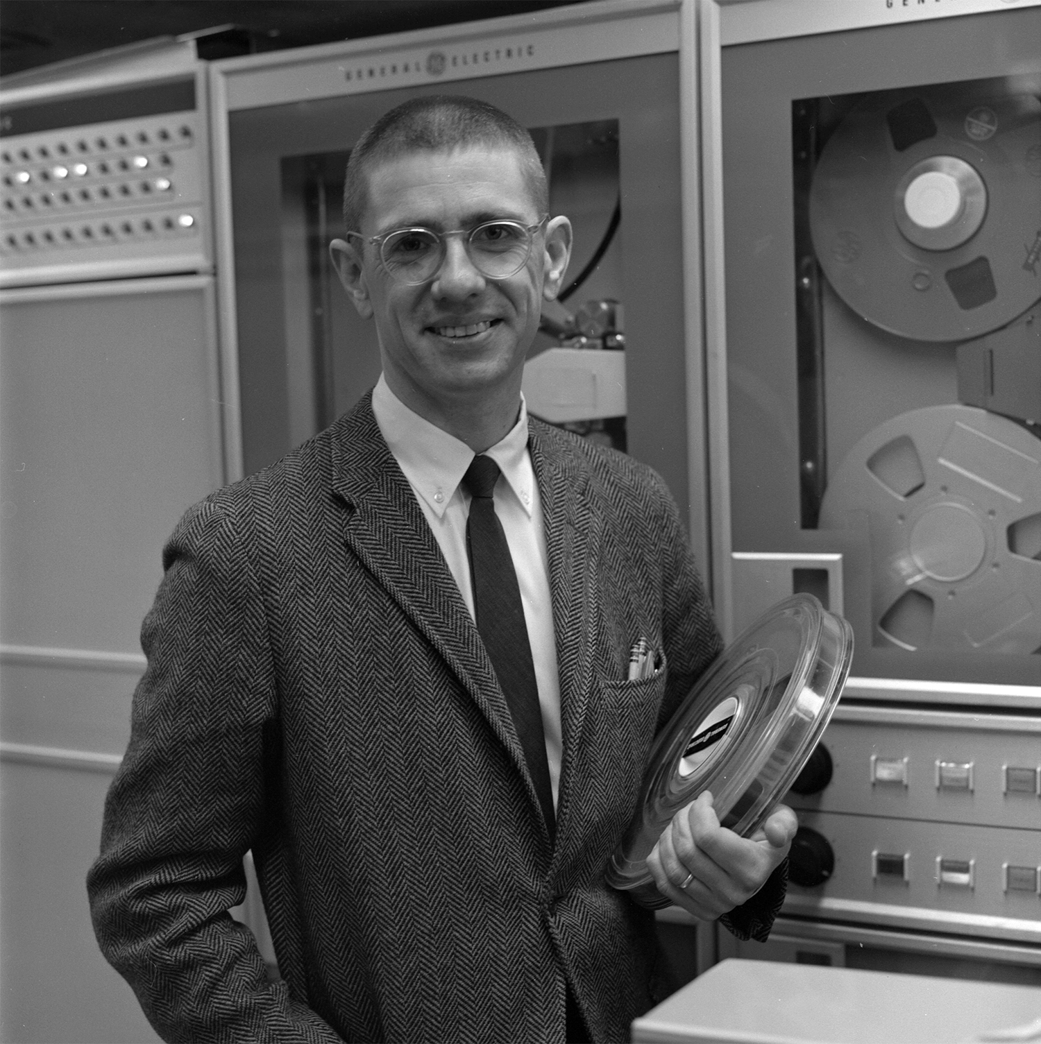 Tom Kurtz, magnetic tape in hand, poses in Dartmouth's computing center in the early days of BASIC