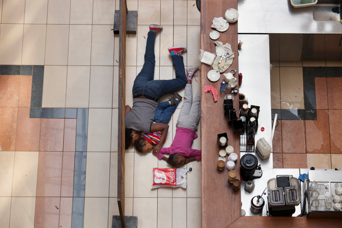 2014 Pulitzer Prize for Breaking News Photography                                                              A woman and child hide inside Westgate Mall in Nairobi, Kenya, Sept. 21, 2013.