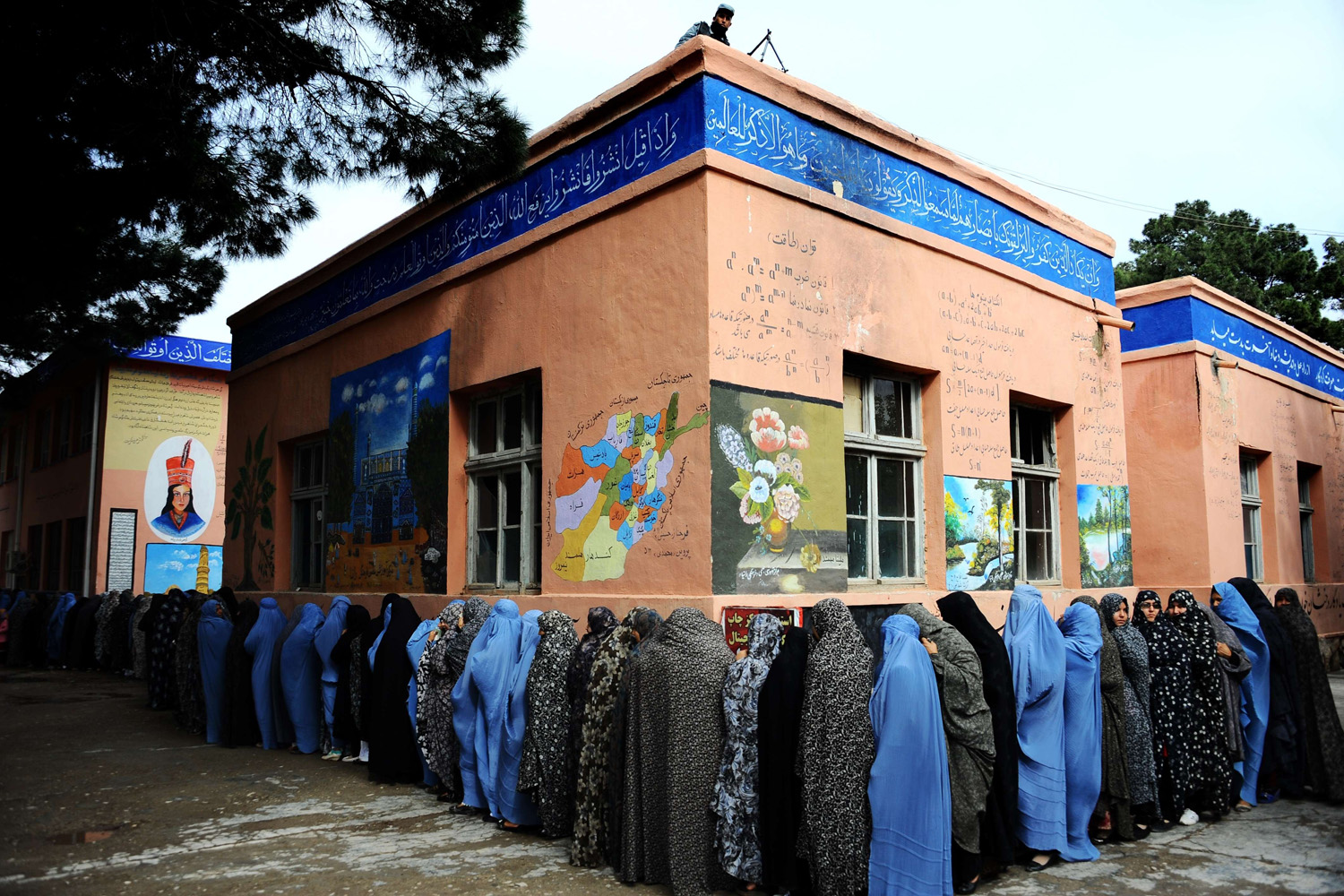 Apr. 5, 2014.                               Afghan women queue outside a school to vote in presidential elections in the northwestern city of Herat. Afghan voters went to the polls to choose a successor to President Hamid Karzai, braving Taliban threats in a landmark election held as US-led forces wind down their long intervention in the country.