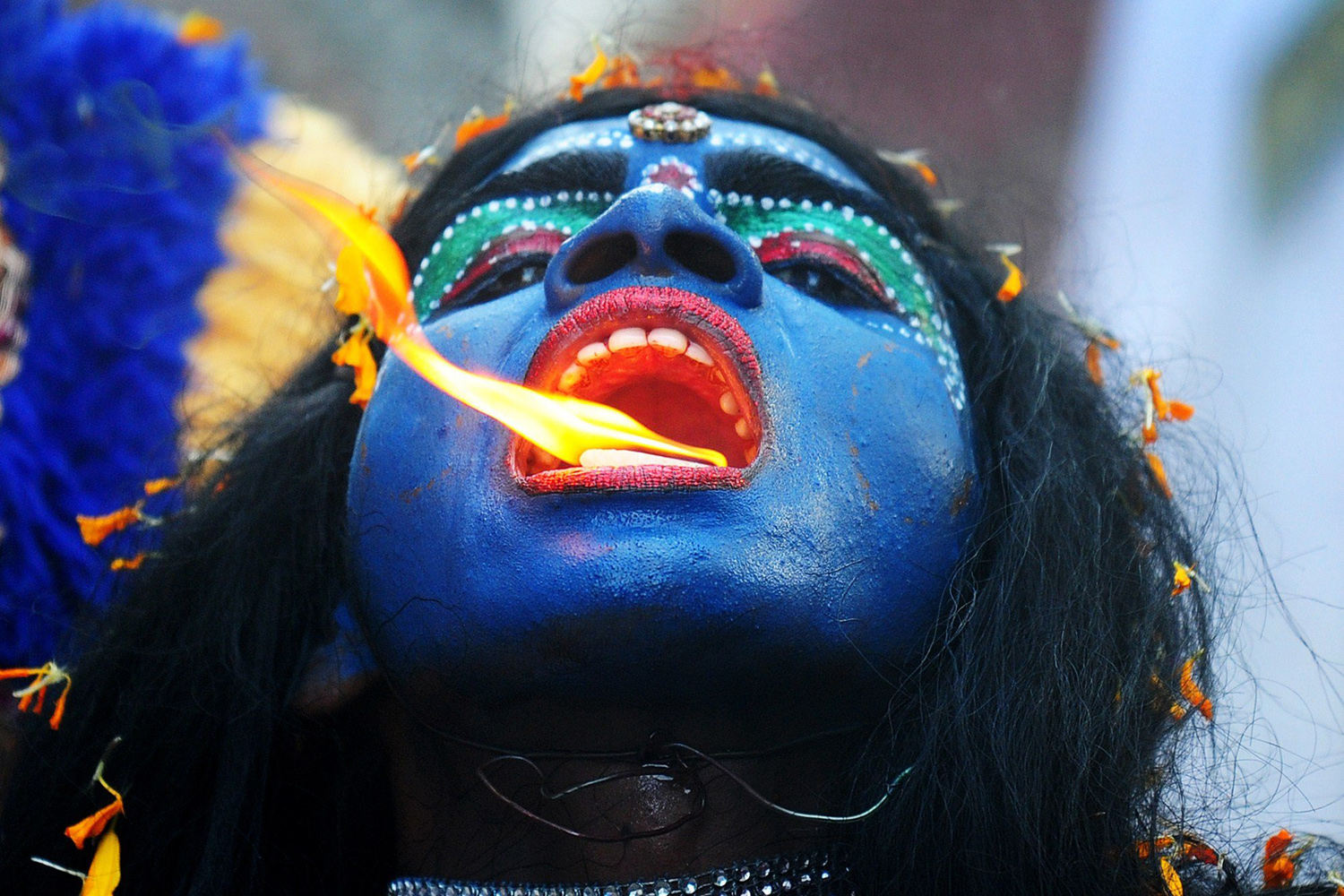 Apr. 8, 2014. An Indian artist dressed as the Hindu goddess Kali participates in a procession to celebrate the Ram Navami festival in Allahabad. Hindu devotees celebrate the festival of Ram Navami, the birth anniversary of Lord Rama, across India, which also marks the end of the nine-day long fasting and Navaratri festival.
