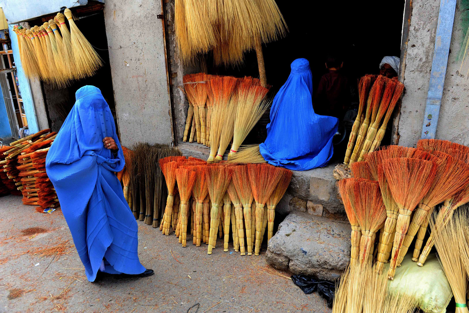 Apr. 9, 2014.                               Afghan shoppers look for brooms at a roadside shop in Herat. Leading candidates in Afghanistan's presidential election voiced concerns that voting was tainted by fraud after millions defied Taliban threats and turned out to choose a successor to President Hamid Karzai.