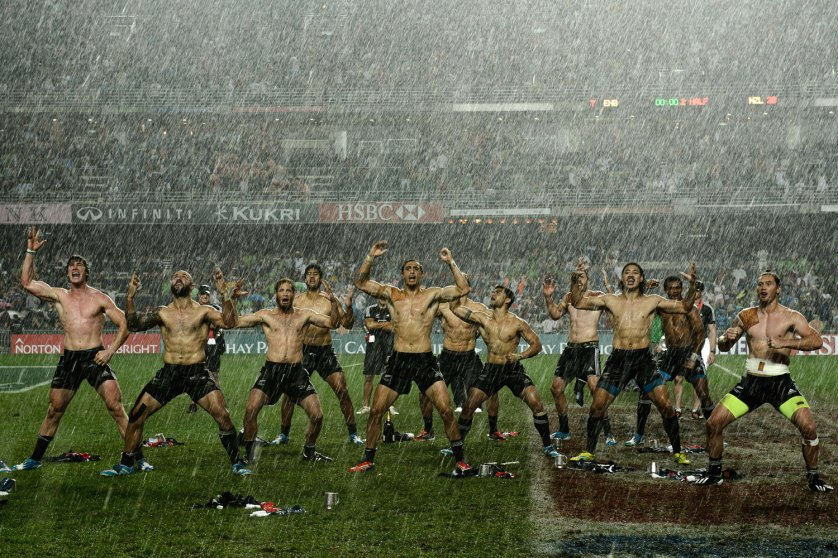 """New Zealand players perform the """"haka"""" in the rain after their victory over England in the final match on the last day of the rugby Sevens Tournament at Hong Kong Stadium March 30, 2014."""