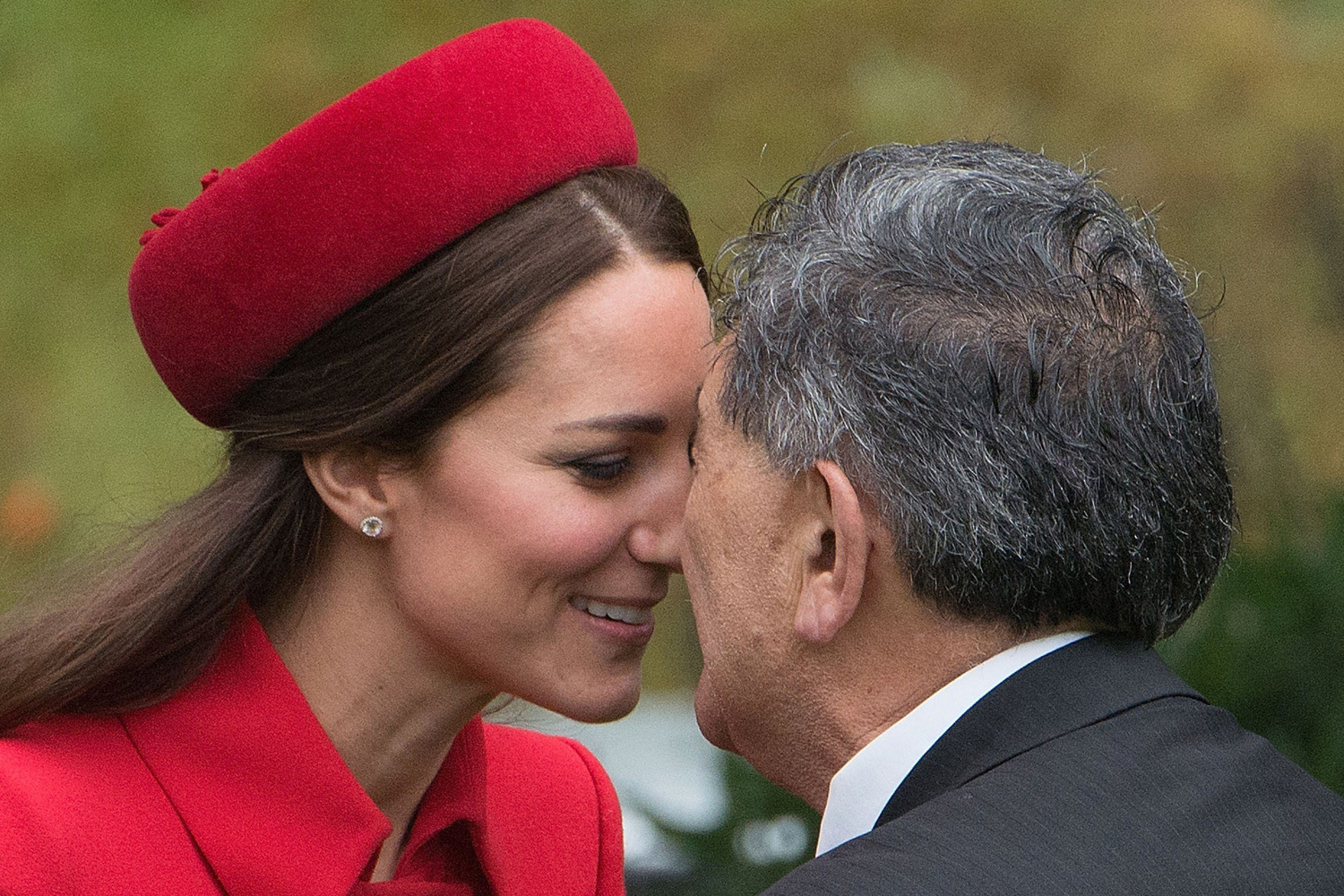 Apr. 7, 2014.                                 Catherine (L), the Duchess of Cambridge, receives a  hongi , a traditional Maori greeting, by a Maori elder during a welcoming at Government House in Wellington. Britain's Prince William, Kate and their son Prince George are on a three-week tour of New Zealand and Australia.