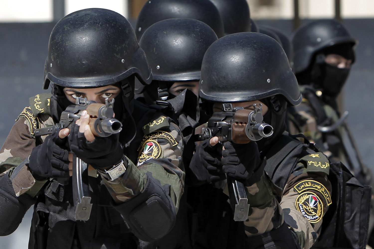 Apr. 6, 2014. Female members of the Palestinian presidential guard take part in a training session in the West Bank city of Jericho.