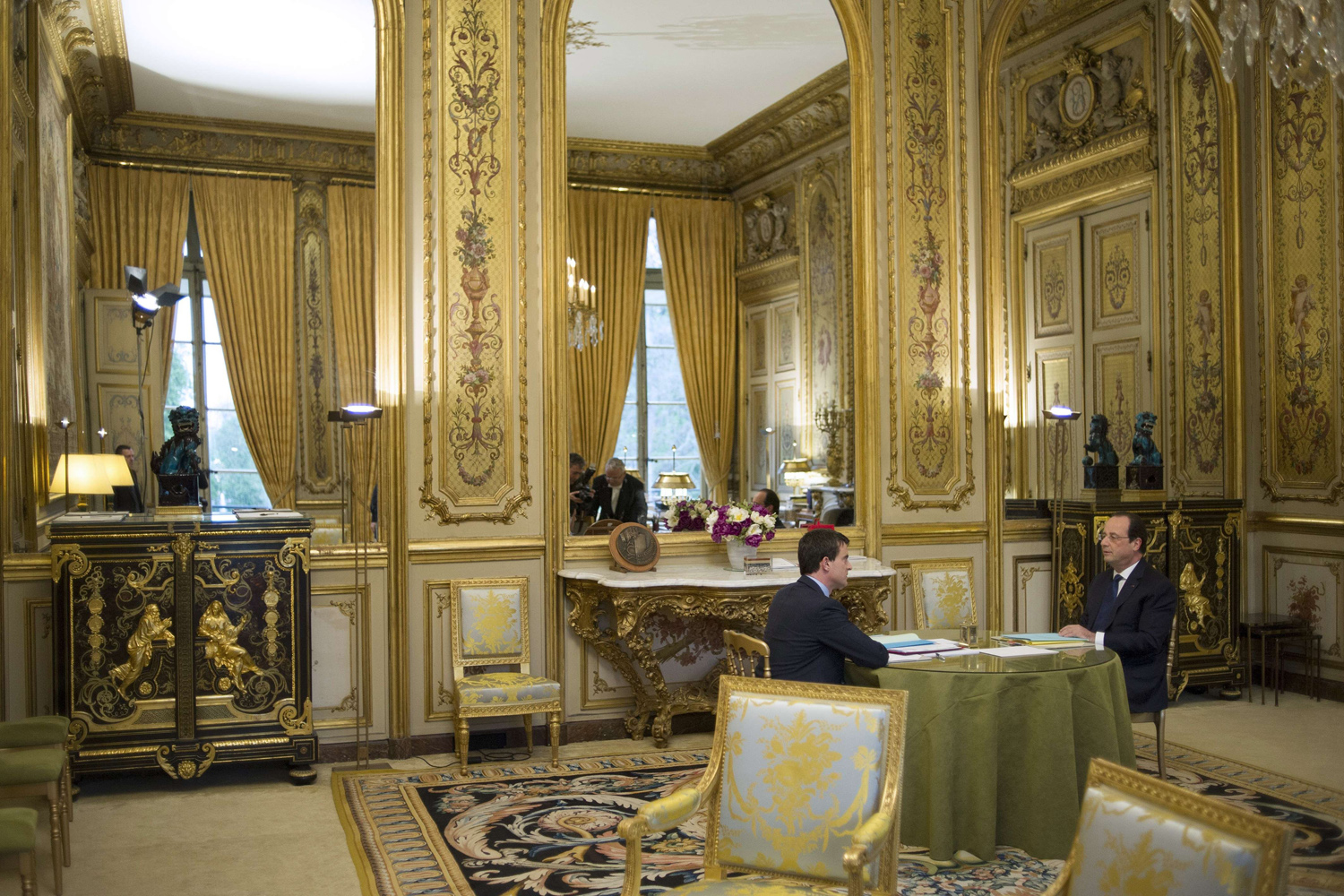 Apr. 4, 2014.                                France's newly appointed Prime minister Manuel Valls (L) speaks with French President Francois Hollande before the first cabinet meeting of his government, at the Elysee Palace in Paris.