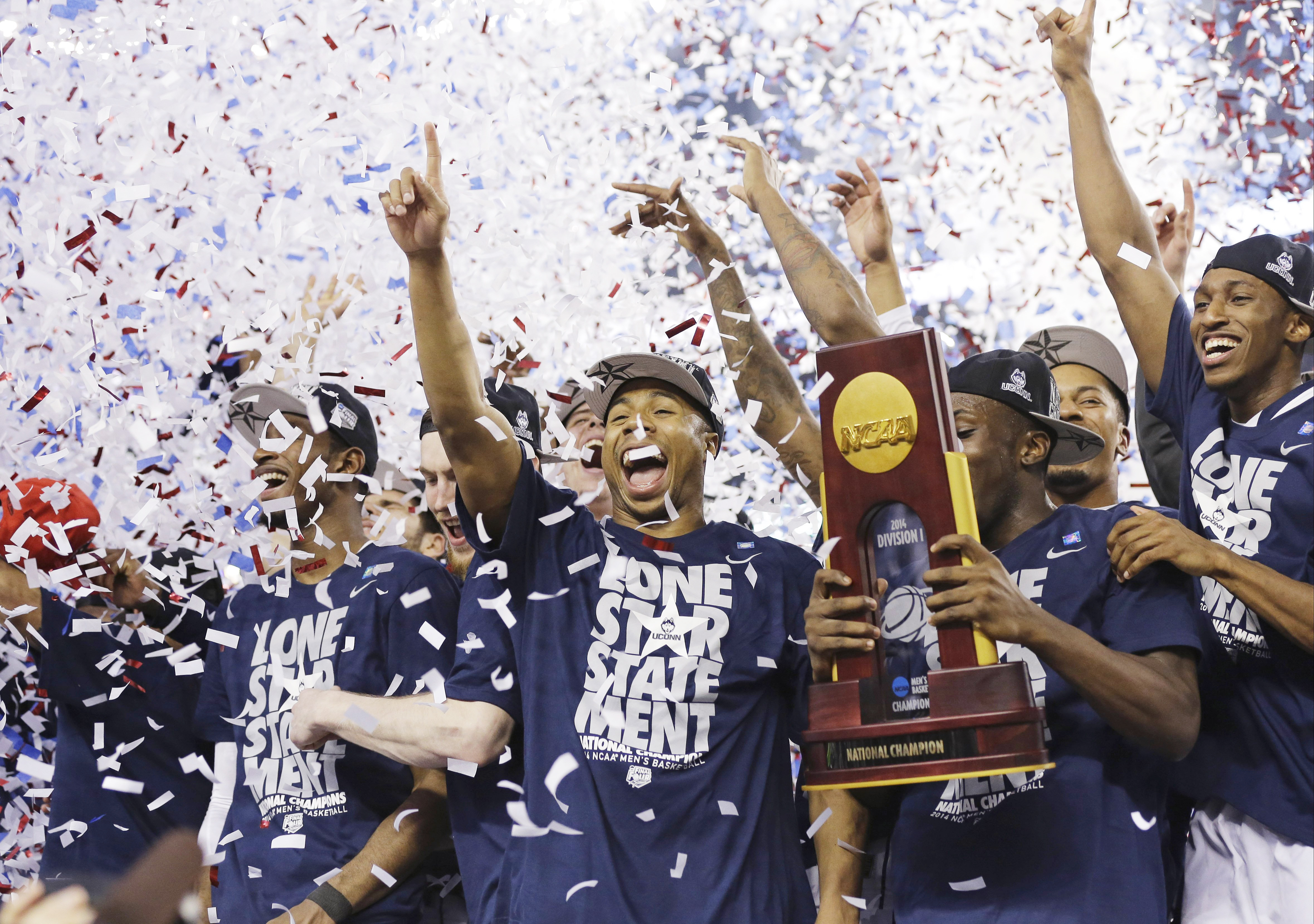 Connecticut celebrates with the championship trophy after beating Kentucky 60-54 at the NCAA Final Four tournament college basketball championship game on April 7, 2014, in Arlington, Texas.