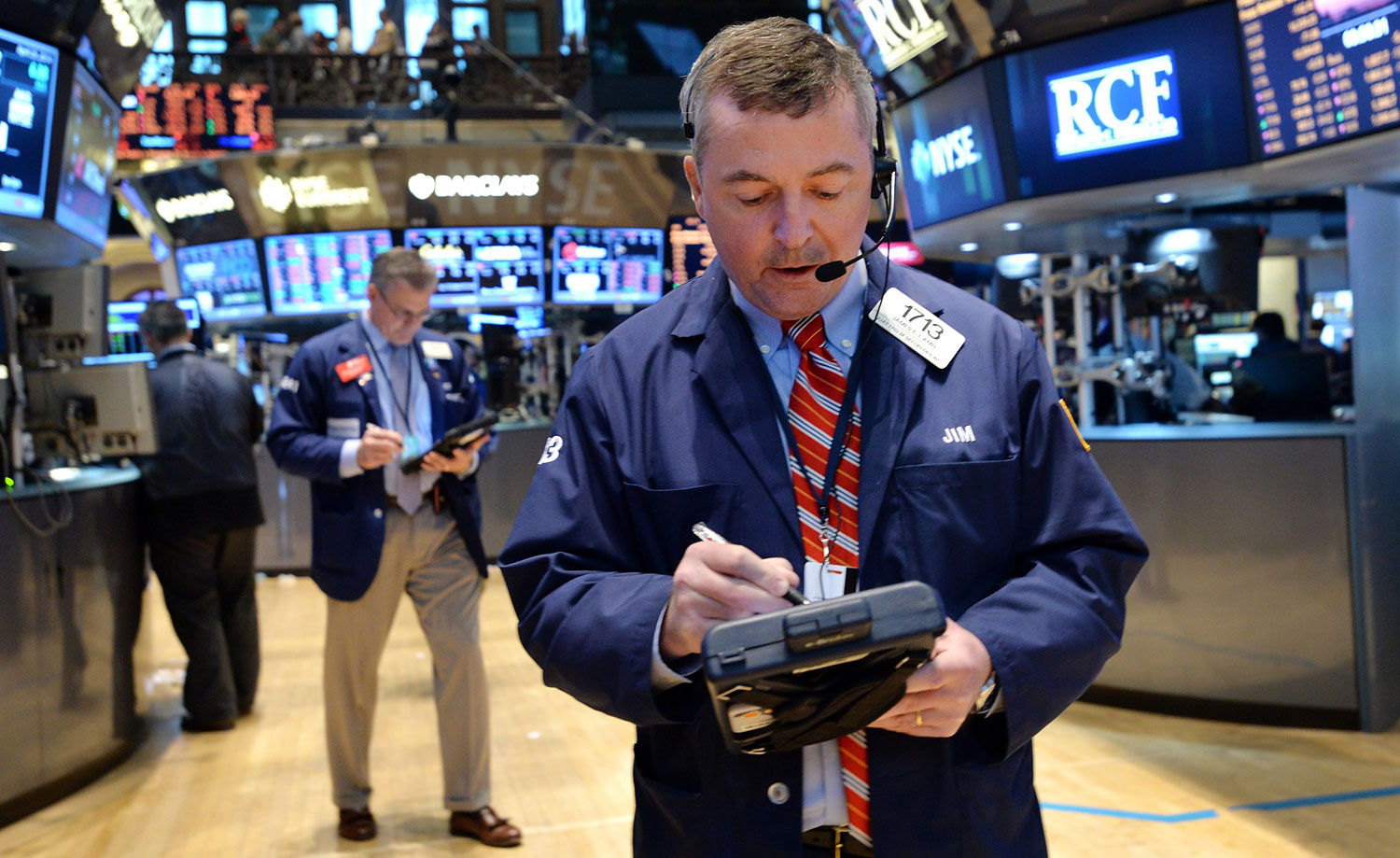 A trader works on the floor of the New York Stock Exchange at the end of the trading day in New York,  April 25, 2014.