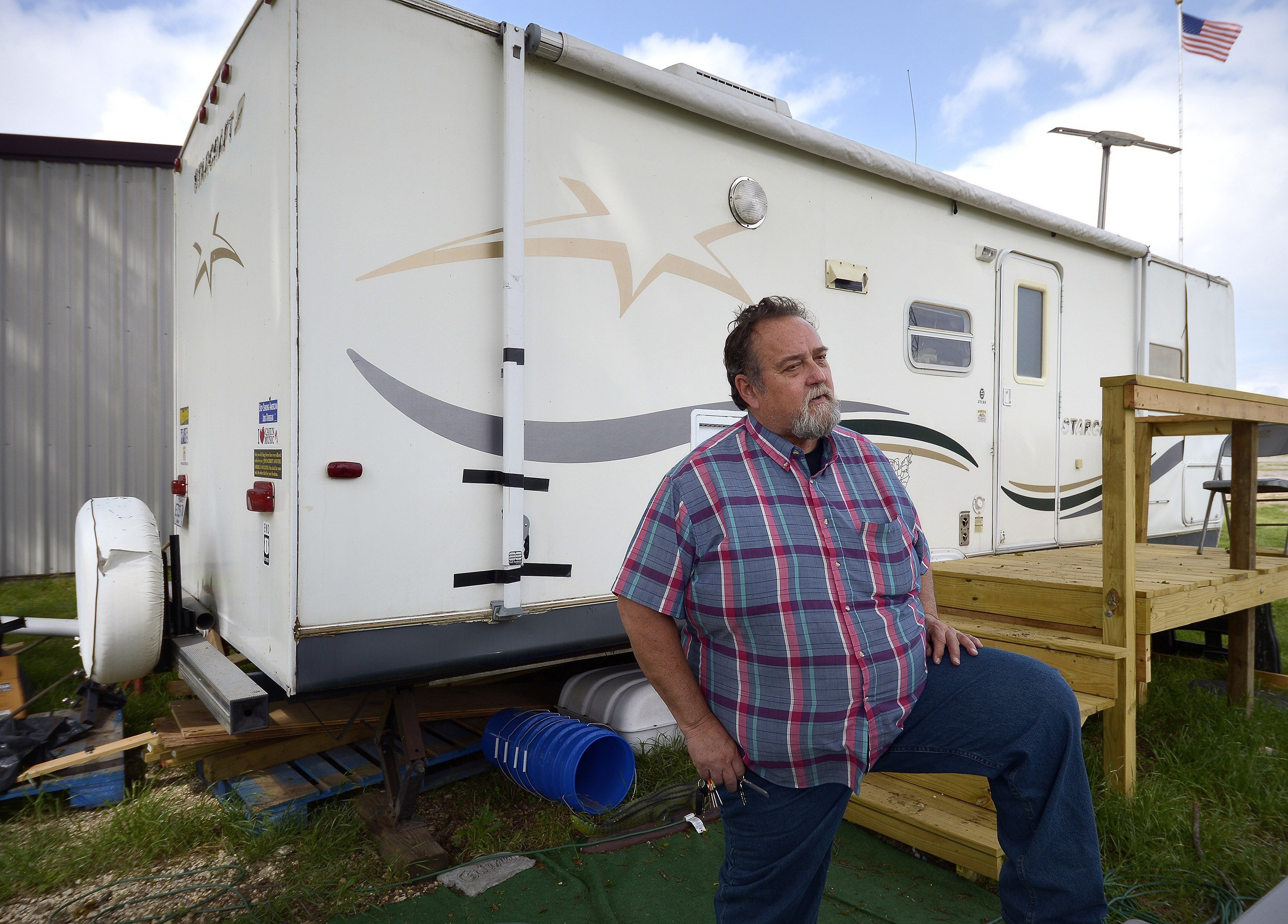 John Raimer stands in front of his trailer that he lives in as he leads at the West Long Term Recovery team in West, Texas, on April 1, 2014.