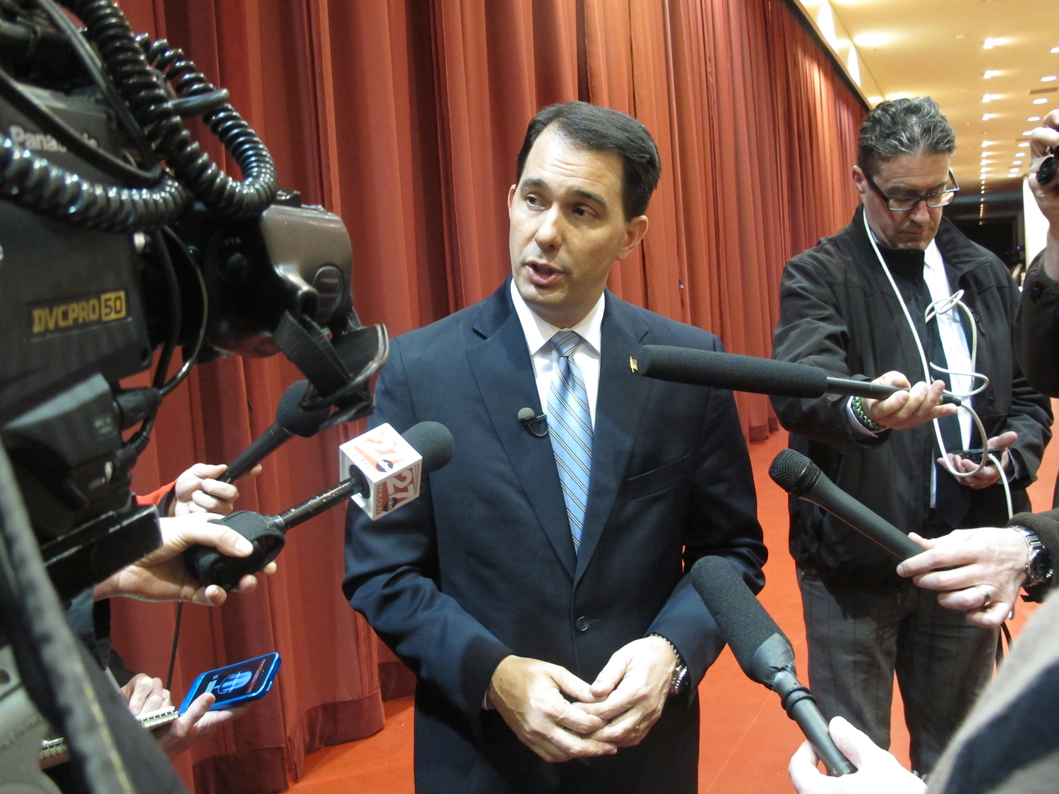 Wisconsin Gov. Scott Walker answers questions from reporters on April 16, 2014, in Madison, Wis.