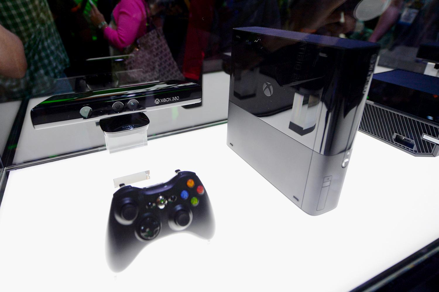 An Xbox One and its controller on display at the Microsoft Xbox booth during the Electronics Expo 2013