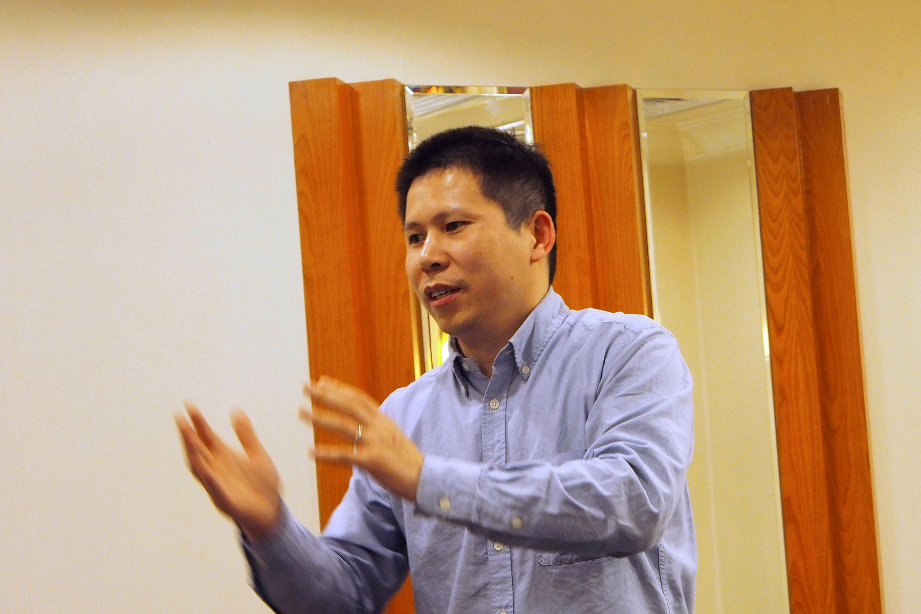 Chinese rights advocate Xu Zhiyong speaks during a meeting in Beijing in this handout photo dated March 30, 2013