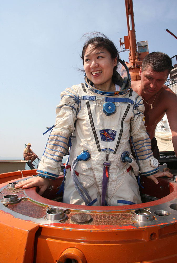 South Korea's first woman in space, astronaut Yi So-yeon is helped by Russian specialists as she undergoes a splashdown landing training session in the Ukrainian Black Sea city of Sevastopol, on July 24, 2007.