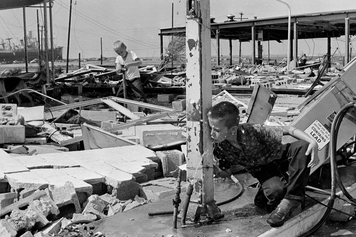 #13 Hurricane Camille - Carl Wright, 11, drinks from a broken pipe amid the ruins of his father's service station in Gulfport, Miss., in the aftermath of Hurricane Camille, Aug. 19, 1969. Fresh potable water was scarce following the storm, which battered the Gulf coast. Although it has been almost 40 years, since the Category 5 storm hit the Gulf Coast, Hurricane Camille is still one of the benchmarks by which all hurricanes are measured. Camille caused $9.2 billion in damages in 2010 dollars.