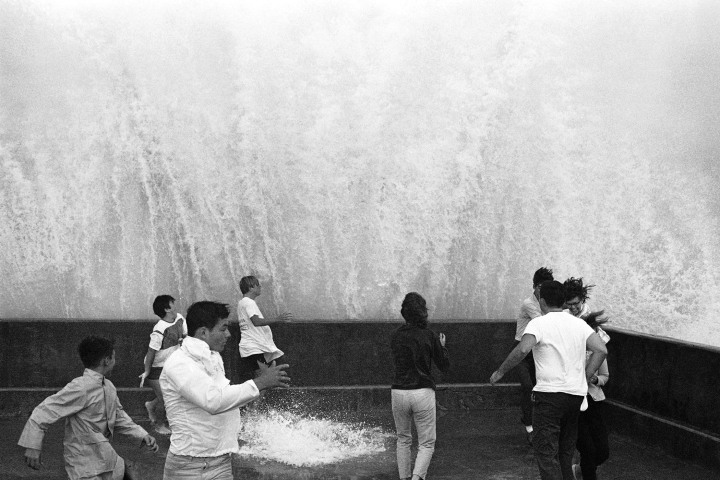 #11 Hurricane Betsy - Thrill seekers run to escape a giant wave, driven by Hurricane Betsy, as it crashes over a fishing pier wall at Miami Beach on Sept. 7, 1965. Betsy caused $11.2 billion in damages in 2010 dollars—and a similar storm that hit Miami today would cost far, far more.