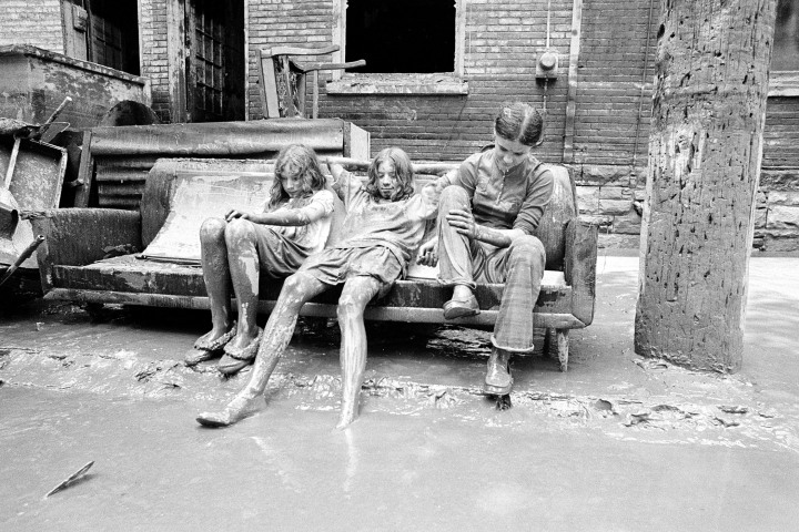 #10 Tropical Storm Agnes - Cindy King, left, her sister Tracy, center, and cousin Cindy Fenstermacher are completely covered with mud as they take a break from cleaning and sit on their sofa outside their flood-damaged home in Harrisburg, Pa., July 27, 1972. Flood waters, caused by tropical storm Agnes, receded in the city and home owners returned to clean up. Agnes caused far more damage inland than most storms, with $11.7 billion in 2010 dollars.