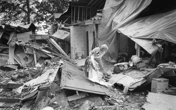 #8 Hurricane Hugo - Kitty Hicks salvages a few items from her home in Hemby Bridge, N.C., Sept. 29, 1989. The house was destroyed by a tree during Hurricane Hugo, which had winds up to 135 mph. The massively powerful Hug caused $12.7 billion in damages, and killed more than 100 people.