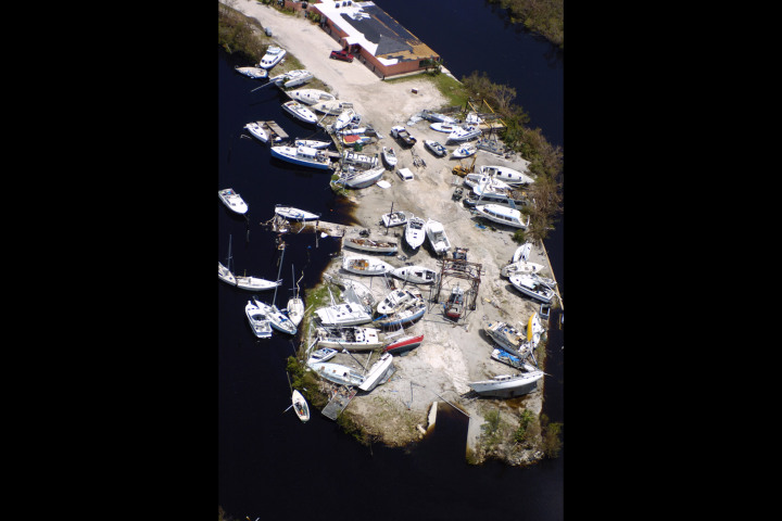 #7 Hurricane Charley - Boats lie scattered like broken toys in a boat yard at Punta Gorda, Fla. August 15, 2004. Hurricane Charley battered the town with 145 mph winds and caused nearly $16 billion in damages, and killed 15 people directly.