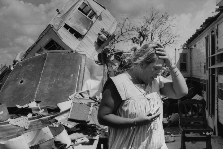 #3 Hurricane Andrew - Stunned mobile home owner Carol Mostacero stands in front of the overturned wreckage of her residence on August 26, 1992, following the wrath of Hurricane Andrew. Andrew blew through Florida, causing an astounding $45 billion in damages, and killed over 50 people. At the time, it was the most expensive storm in U.S. history.